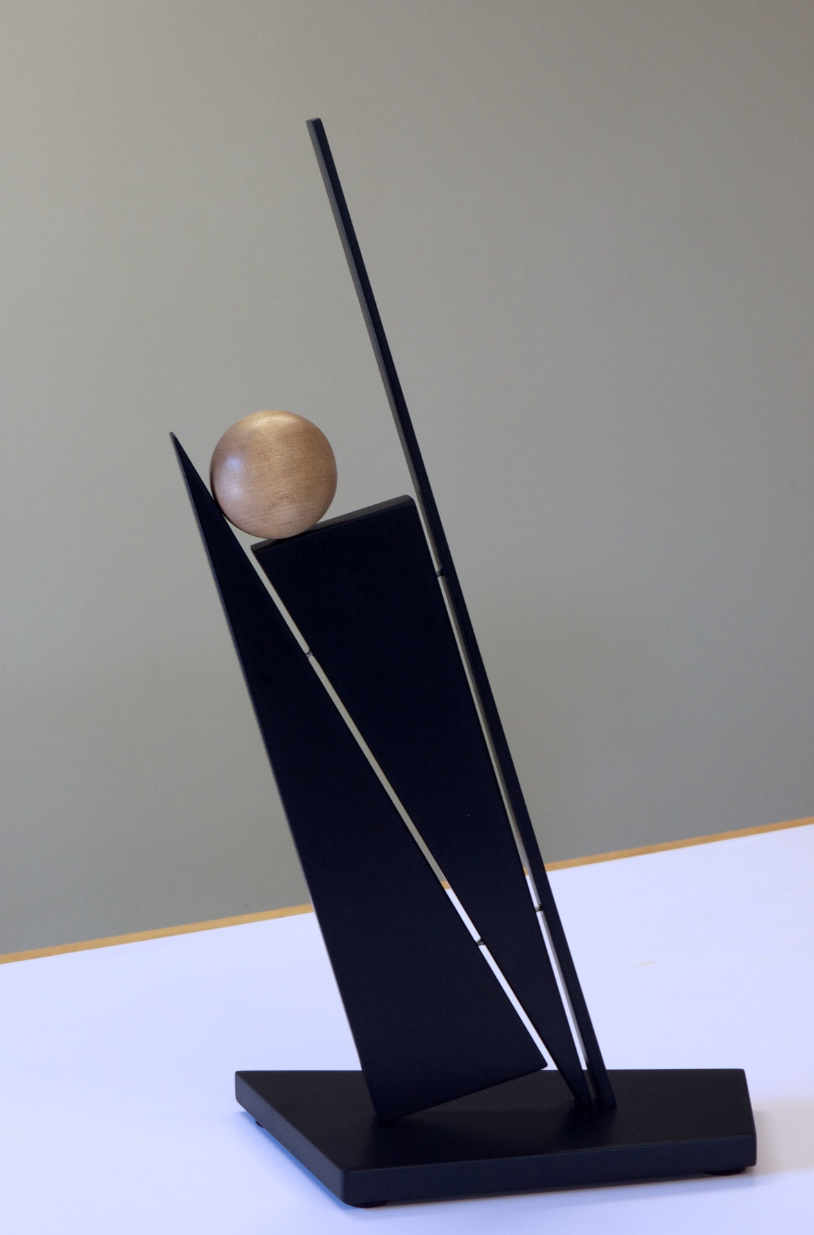 "John Schwartzkopf  (BIO)   ""Balancing Act,"" 2012  paperstone and maple  21"" x 12"" x 6"""