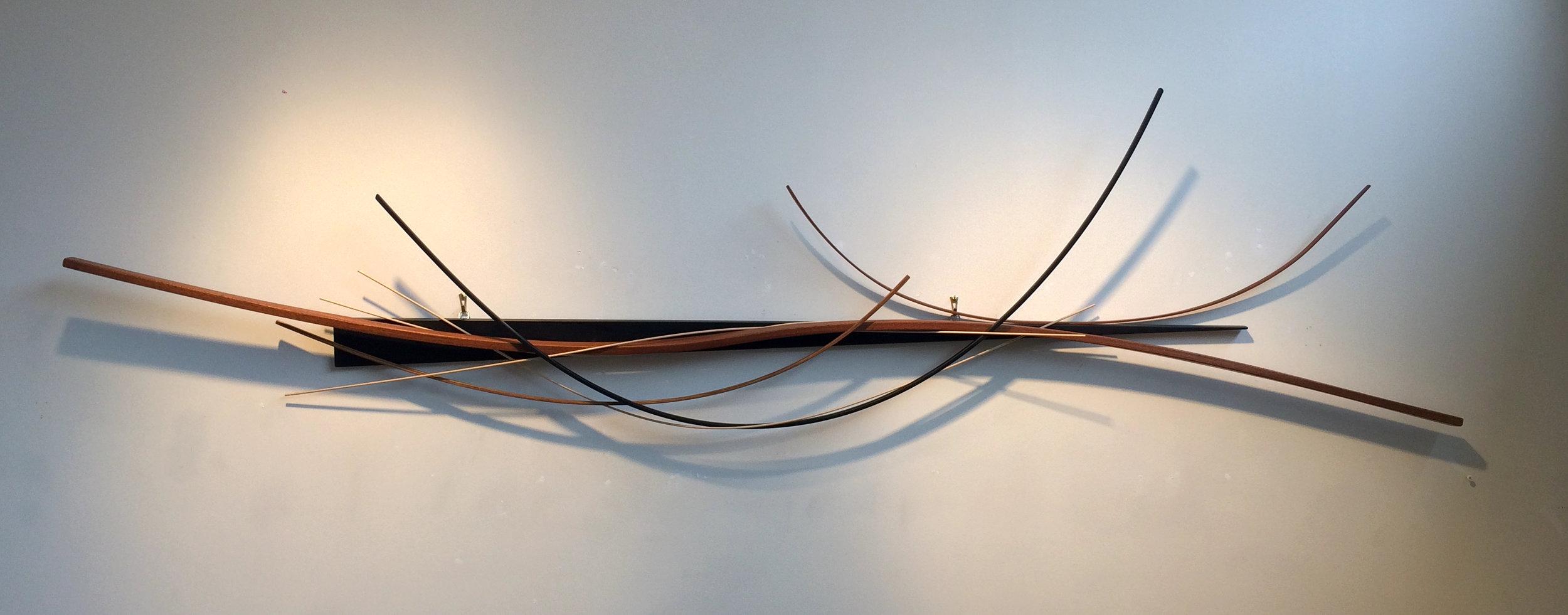 "John Schwartzkopf  (BIO) ,   Wedged Arc  , 2012, paperstone, mahogany, various woods,31 1/2"" x 82"" x 5"""