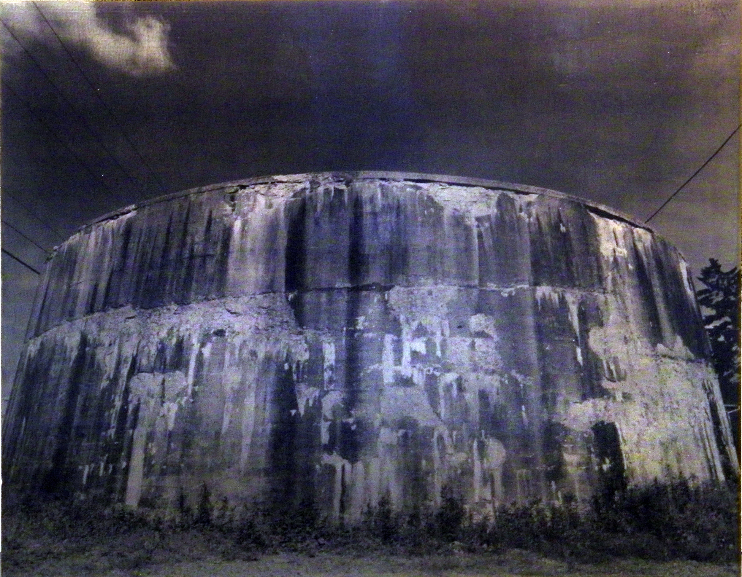 "Carl Goldhagen    (BIO) ,   Lava Tank  , 1994, photo emulsion on lead 1/3, 29 1/2"" x 37"""