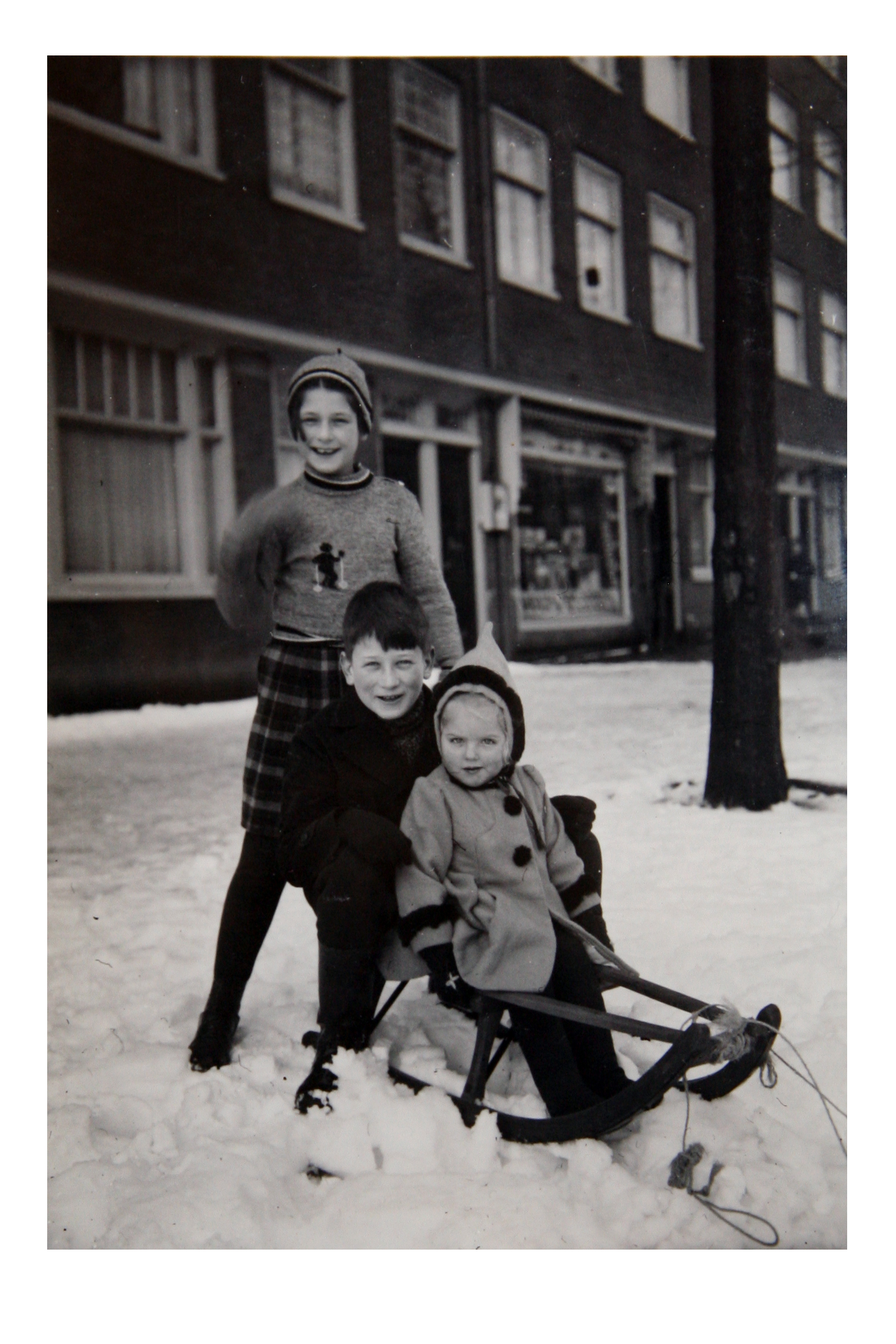 Irene, Werner, and cousin sledding along the canals of Amsterdam, circa 1941.