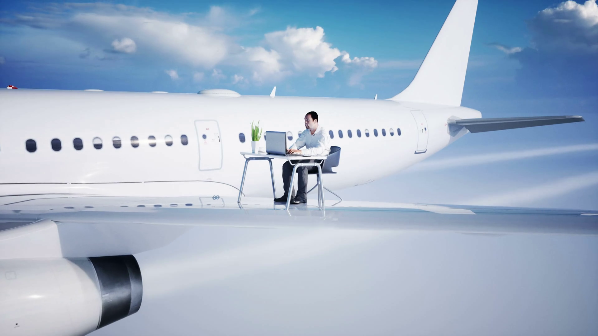 videoblocks-young-busy-businessman-working-on-the-flying-airplane-african-male-looking-into-the-screen-of-the-laptop-on-the-desk-creative-workspace-concept-realistic-4k-animation_bqz6j88ig_thumbnail-full01.png