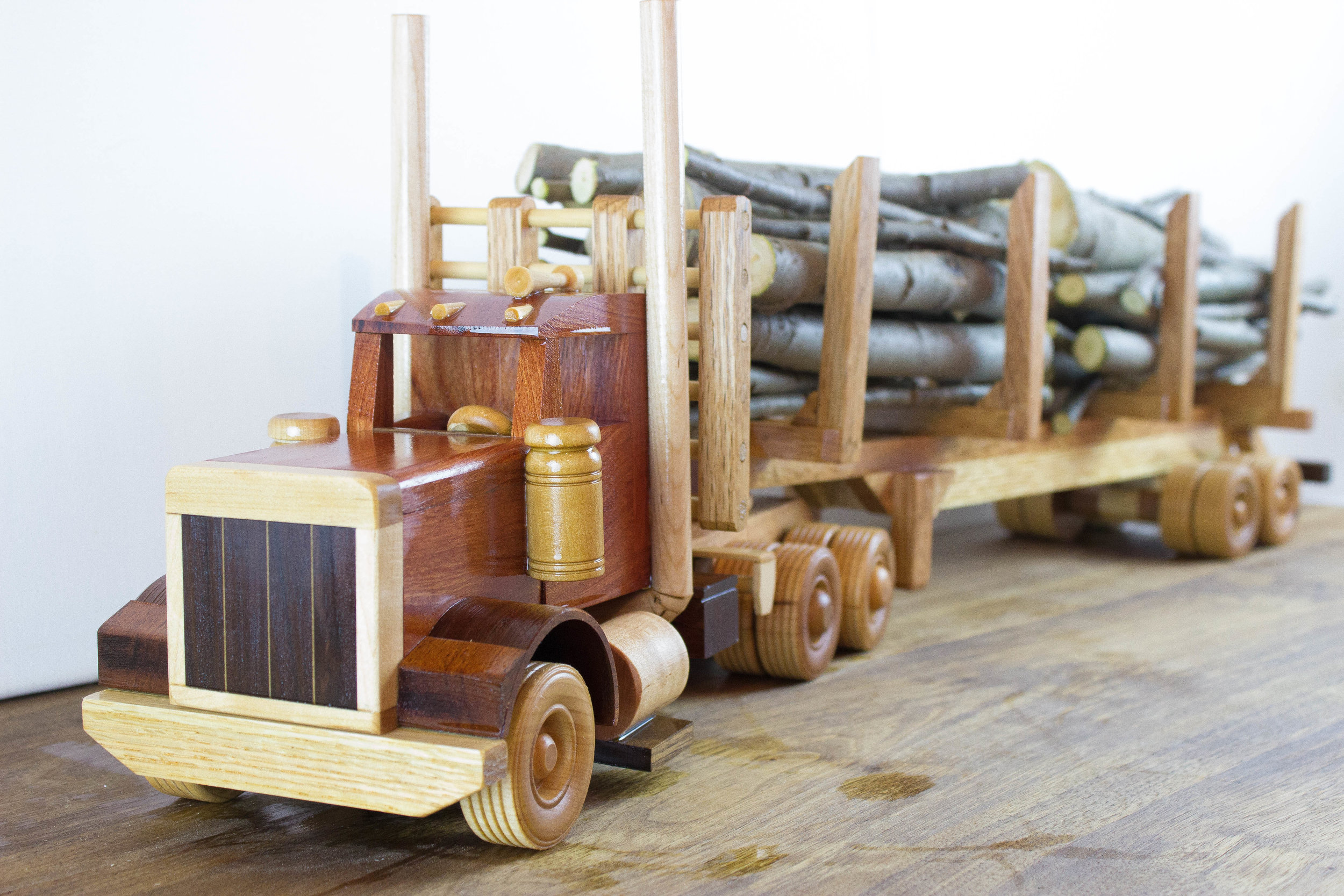 Logging truck toy, all natural wood.