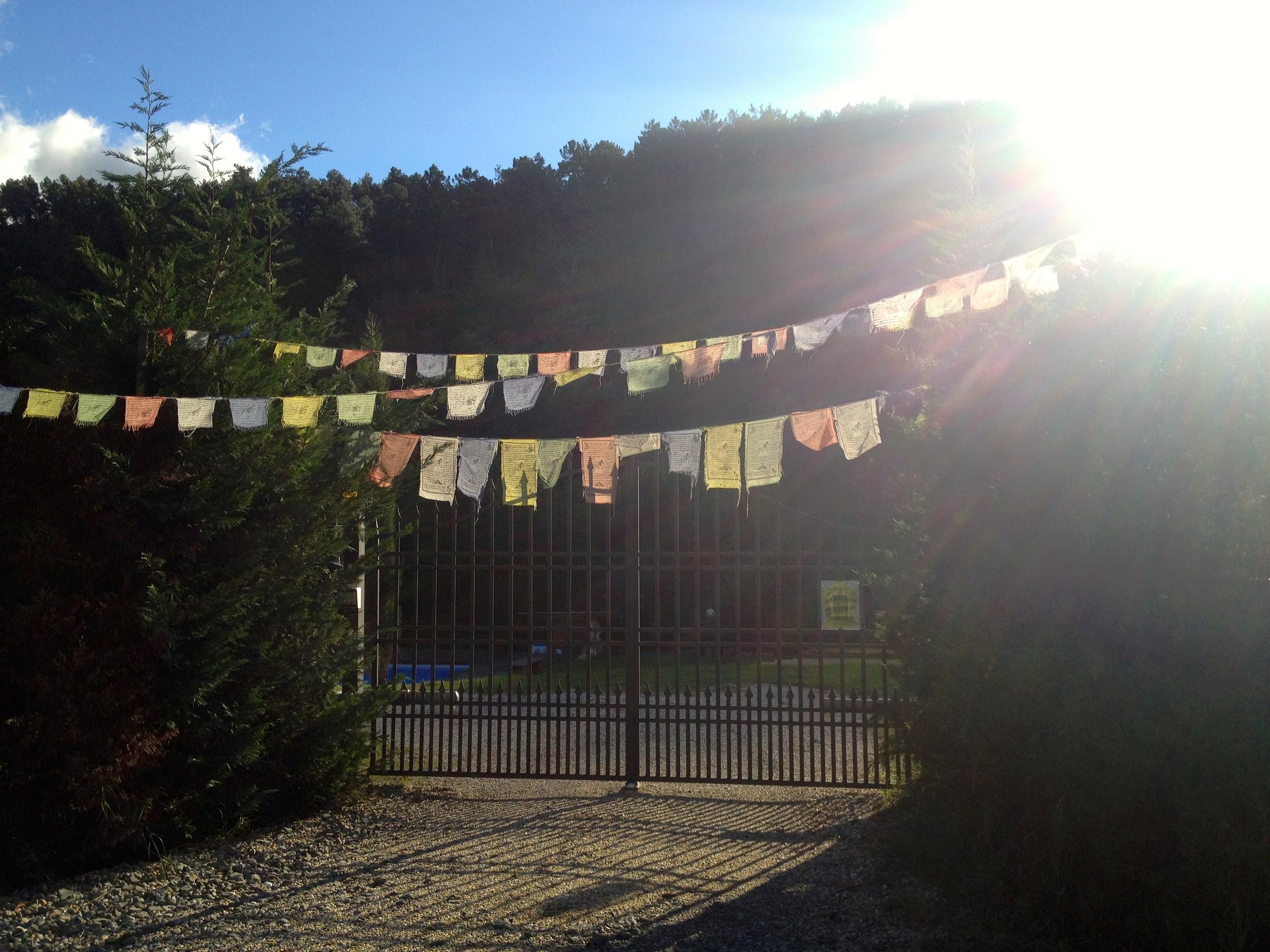 Tibetan prayer flags outside a property along the Via Francigena near Lucca, Italy