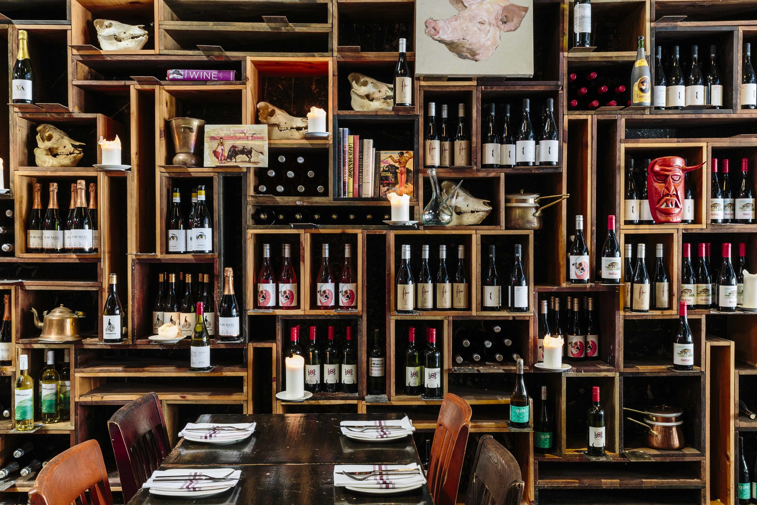 Duende interior with wall of wine bottles