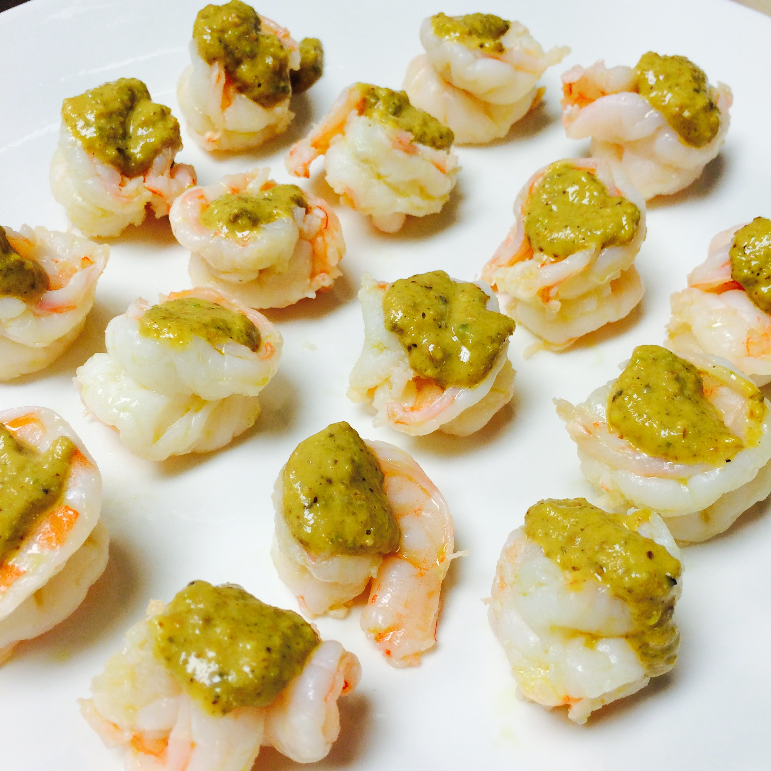 shrimp topped with a green sauce