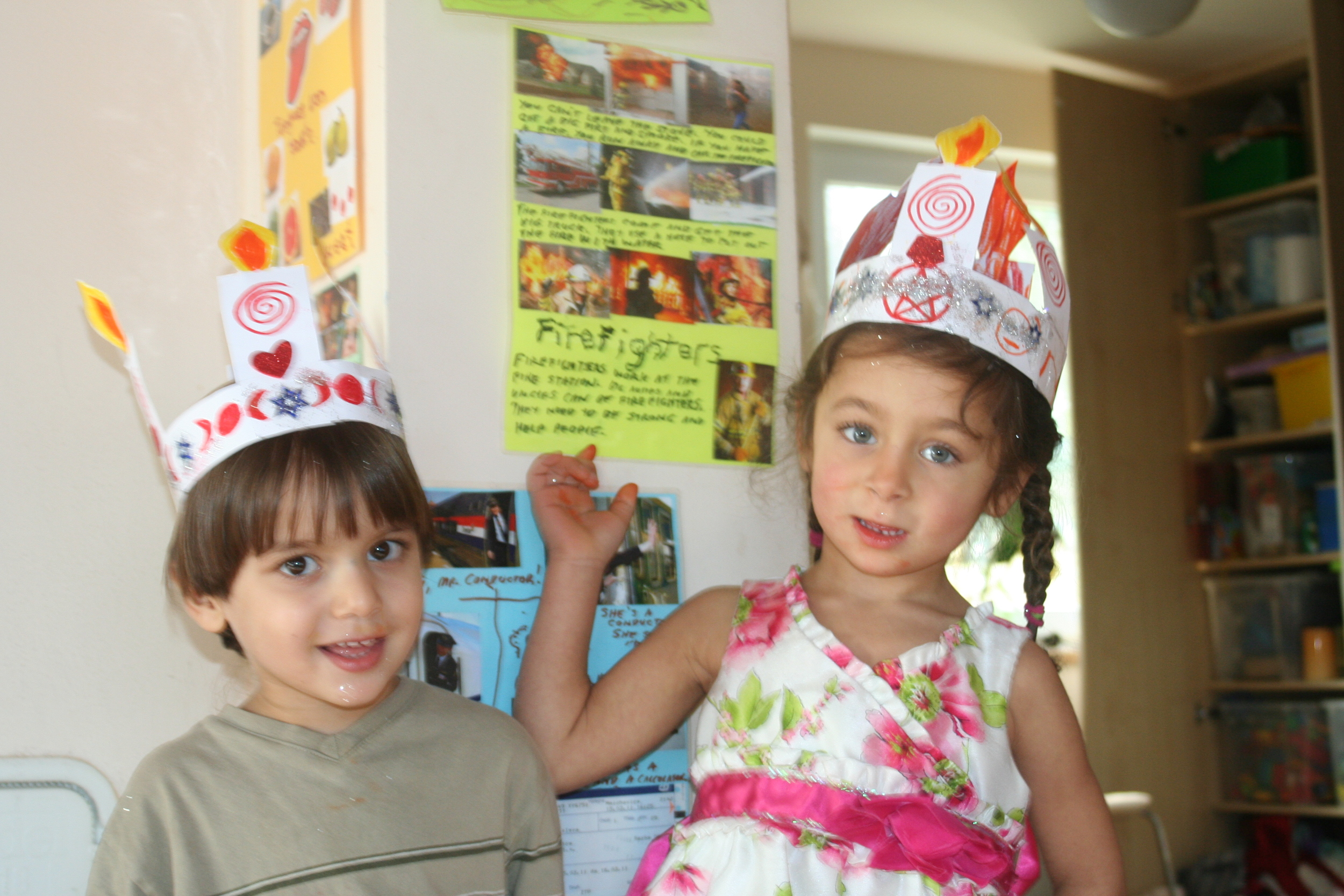 Kids with Imbolc crowns demonstrating fire protection knowledge