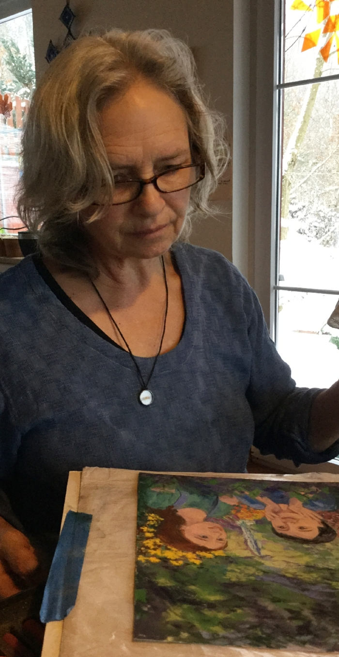 Julie painting imbolc cover of beltane.JPG