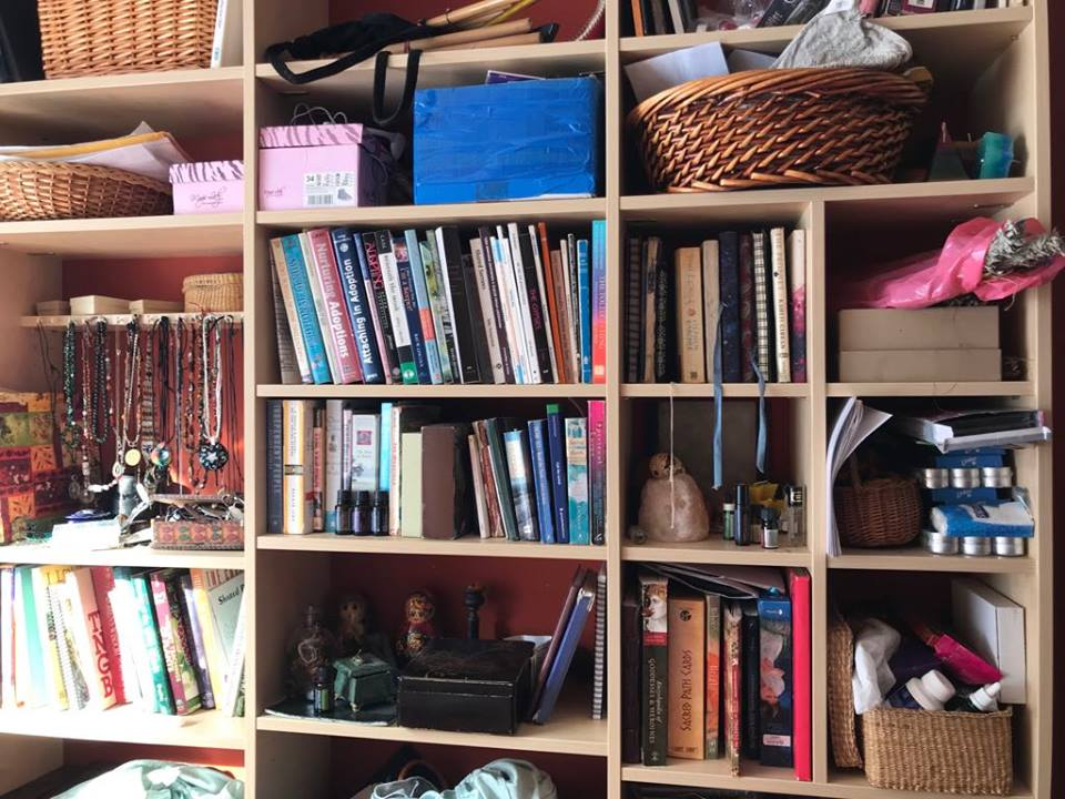 These are the shelves directly on my bed and they combine active bookshelf with cosmetics and jewelry stations, spiritual practice supplies and things I really need to hide from my children. - Image by Arie Farnam