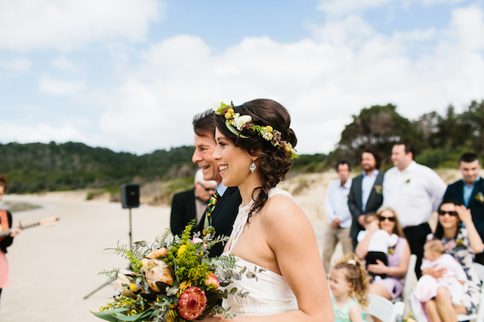 Nina's mum made her bouquet, and her father had the honour of escorting her to her groom.