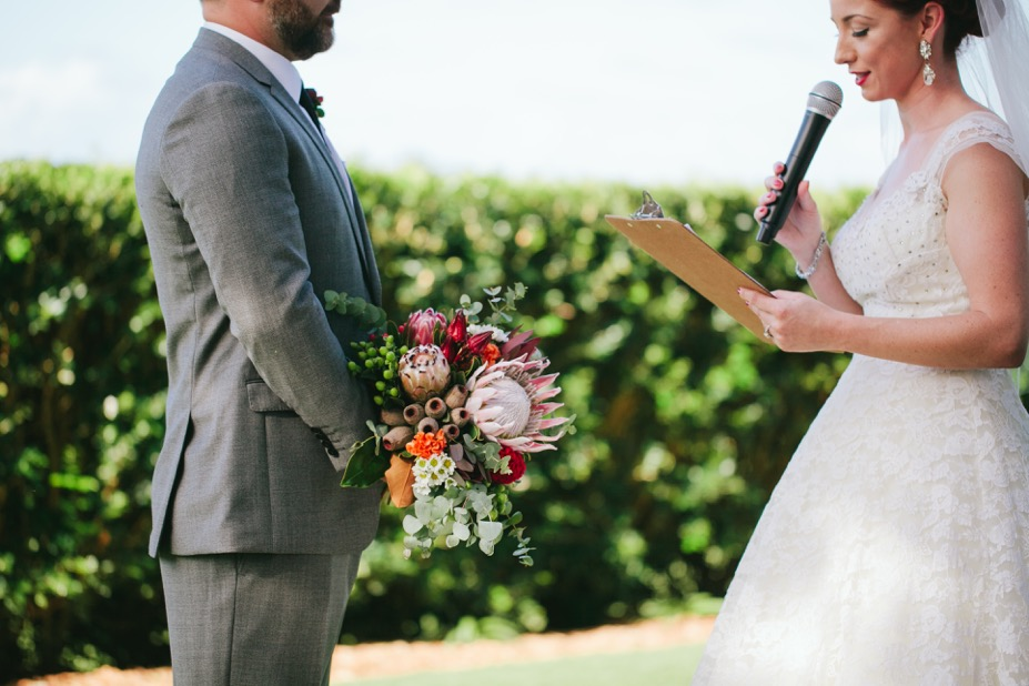 Warrick and Louise chose to read their vows from a vintage wooden clipboard to tie in with their theme. They didn't have a bridal party, so when we rehearsed I suggested that Warrick hold her bouquet while she made her vows. I LOVE the way this looks (insert love heart eyes).