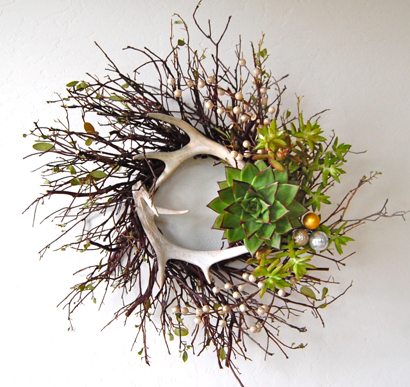 "DEER ANTLER MANZANITA WREATH   21""w – $155."