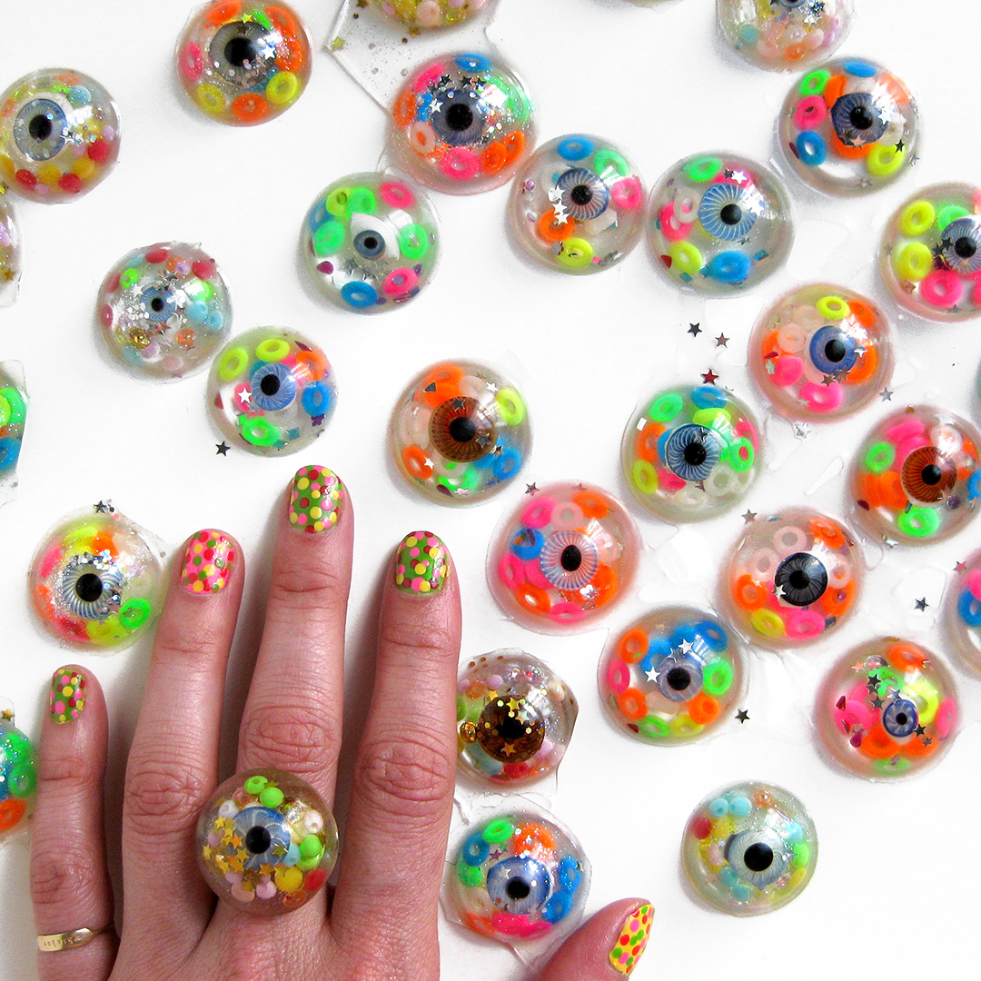 Each ring is unique, both because I use one of a kind antique glass doll eyes, but also because of the unpredictable nature of resin & glitter.