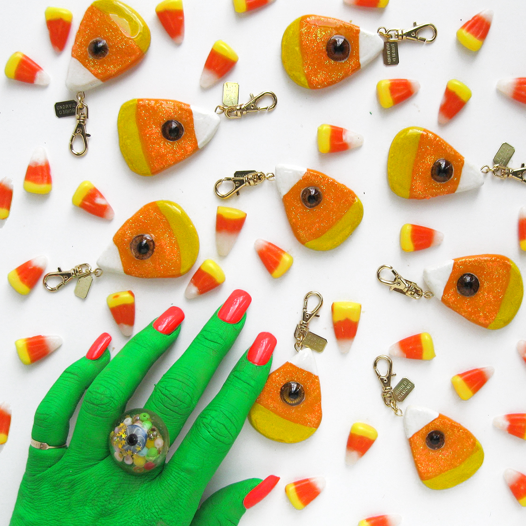 Candy Corn with neon orange glitter and a brown antique glass doll eye.