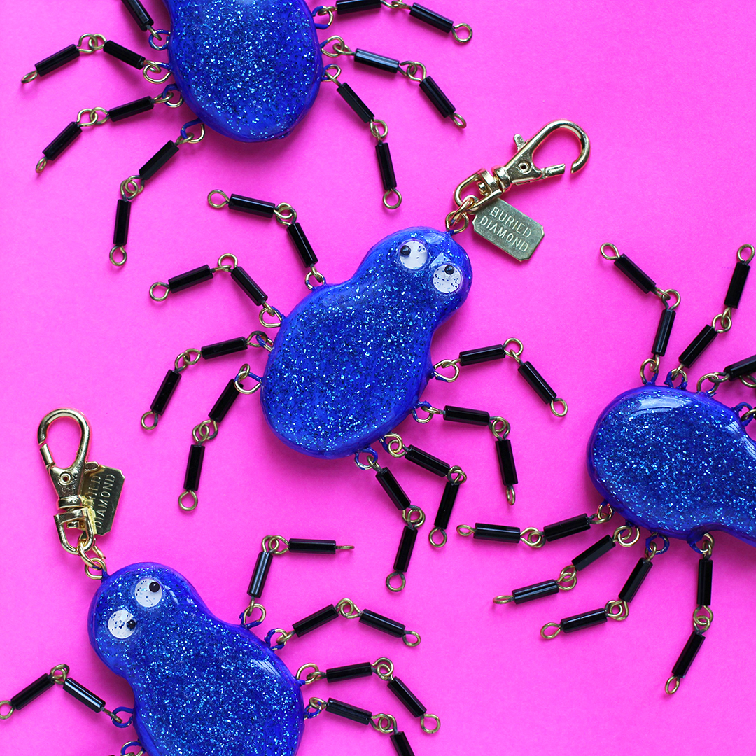 Only 4 of these exist! Spiders are coated with crazy sparkley blue glitter, and they have little googley eyes. Legs are glass bugle beads and are fully articulated. The legs hang limp when worn on a necklace. Between the glitter and the eyes and the legs...this is a really active charm!