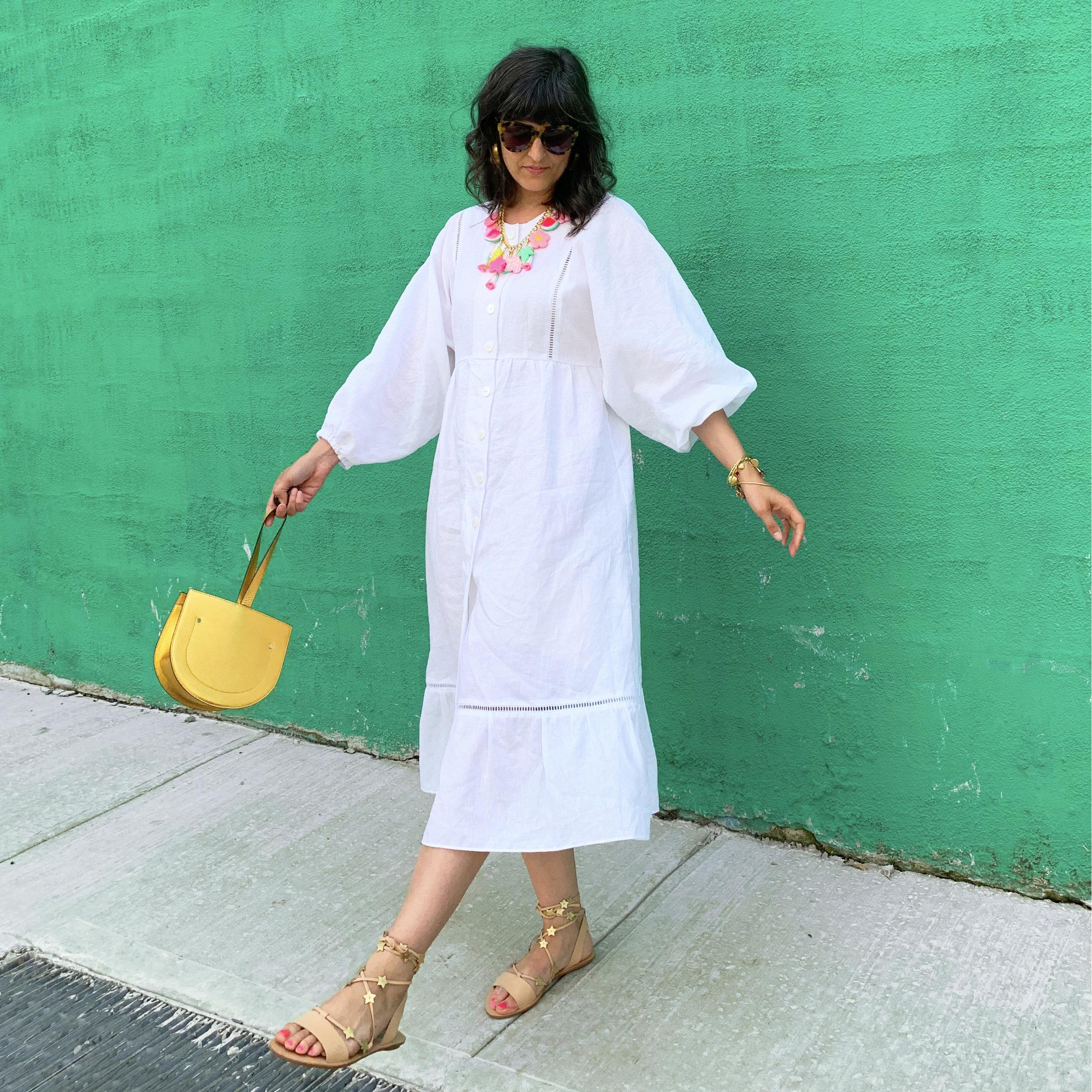 white dress swinging purse.jpg