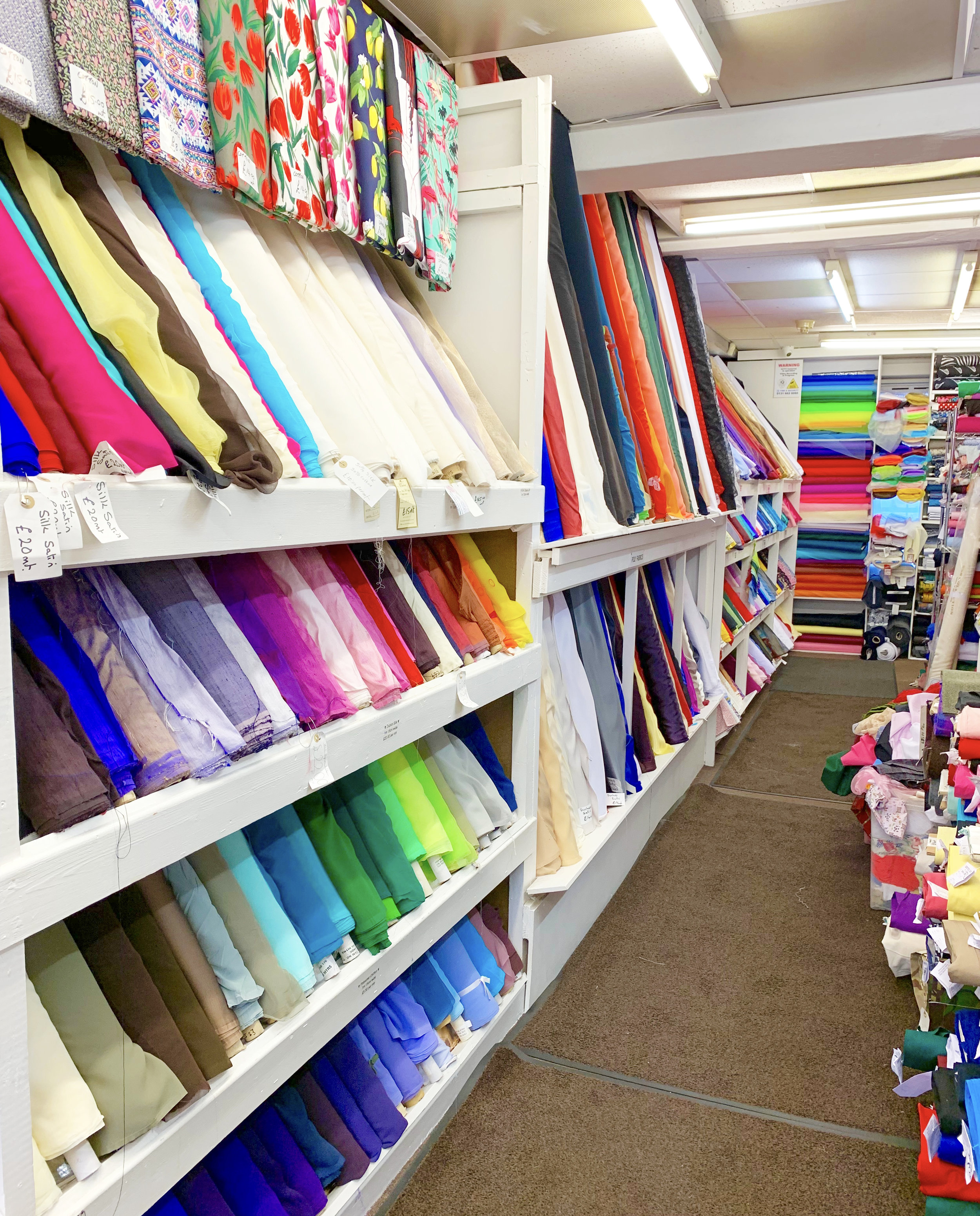 Take a left when you enter Edinburgh Fabrics to be immediately immersed in narrow aisles of densely displayed fabrics!
