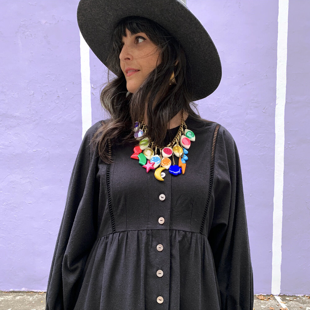 Hat from Westerlind, Necklace by Buried Diamond.