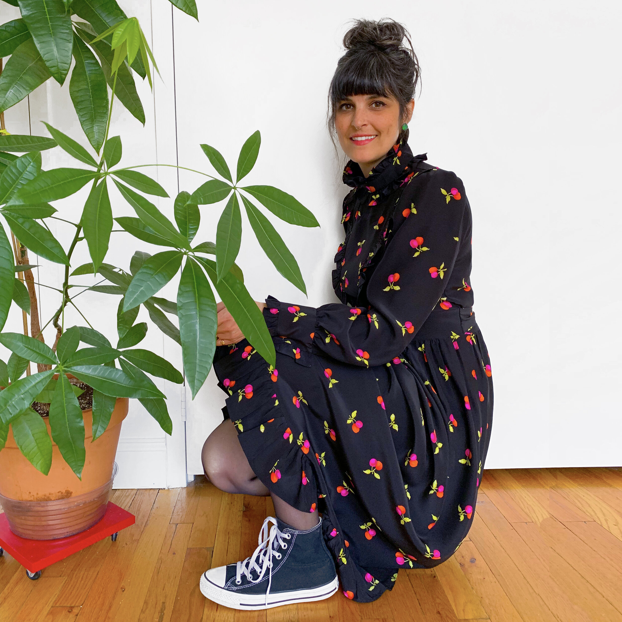 The easiest way to make an over the top silk dress wearable is to pair it with some beat up old Converse.
