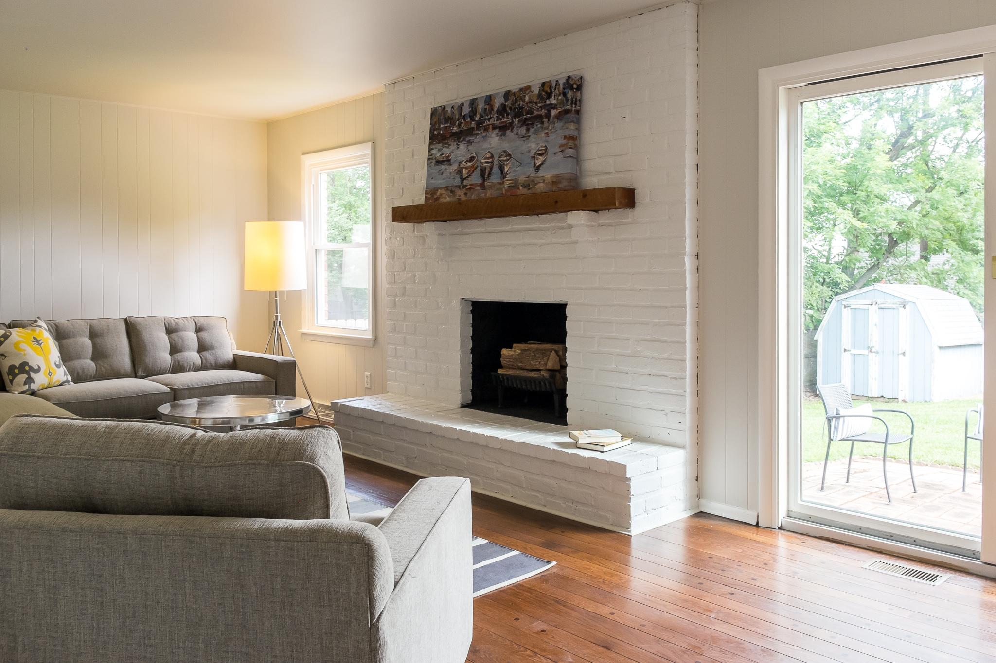 white brick fireplace living room