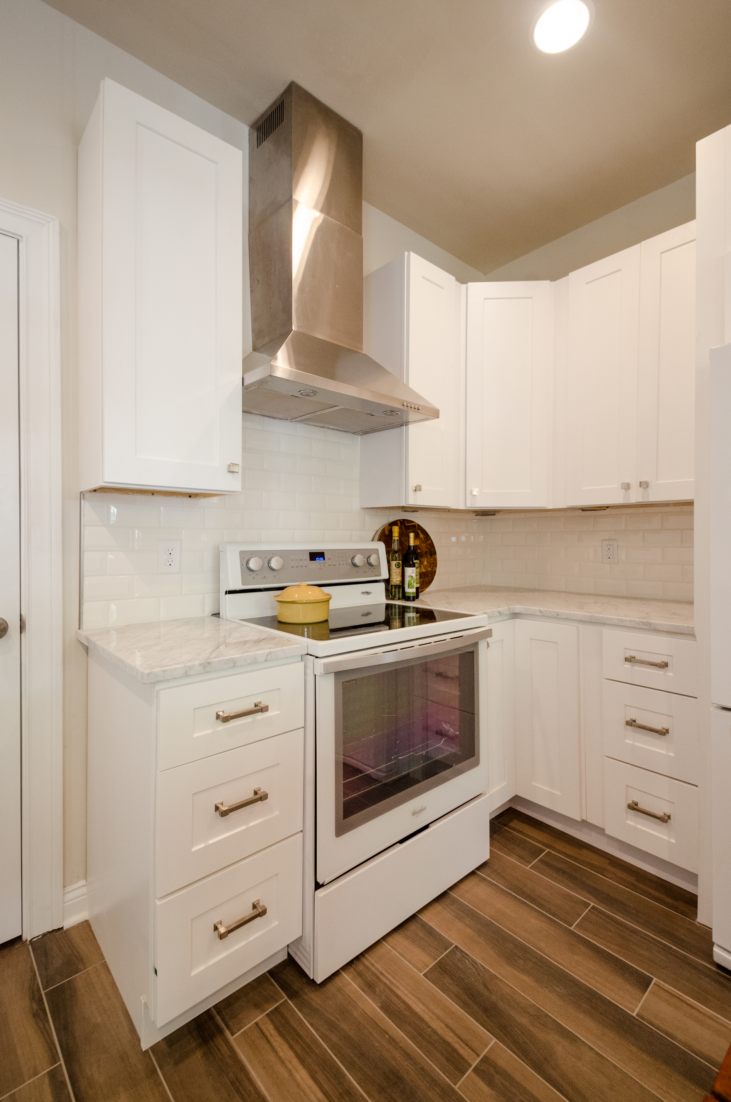 White Cottage Kitchen with Shaker Cabinets and marble counters