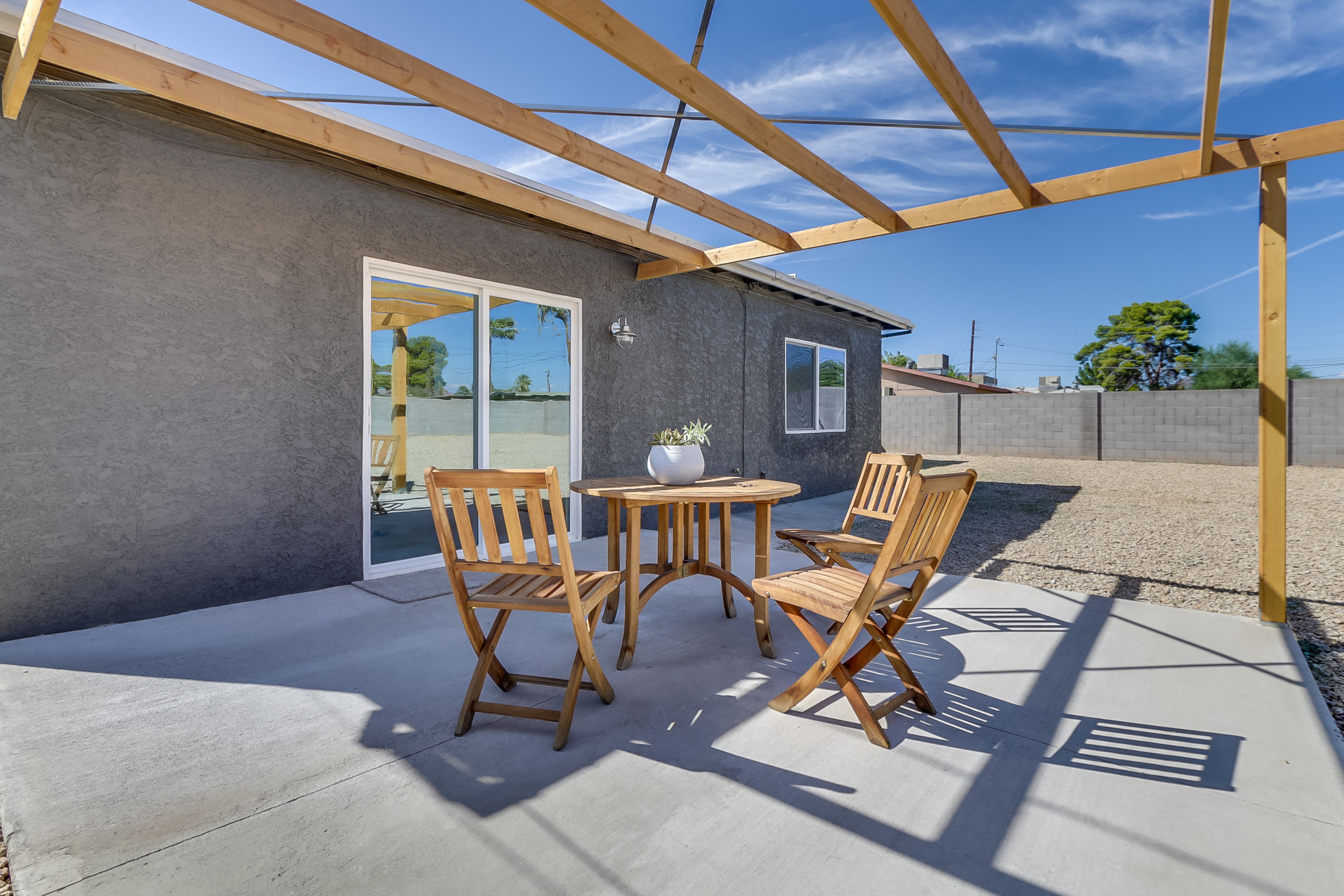 modern pergola and concrete patio