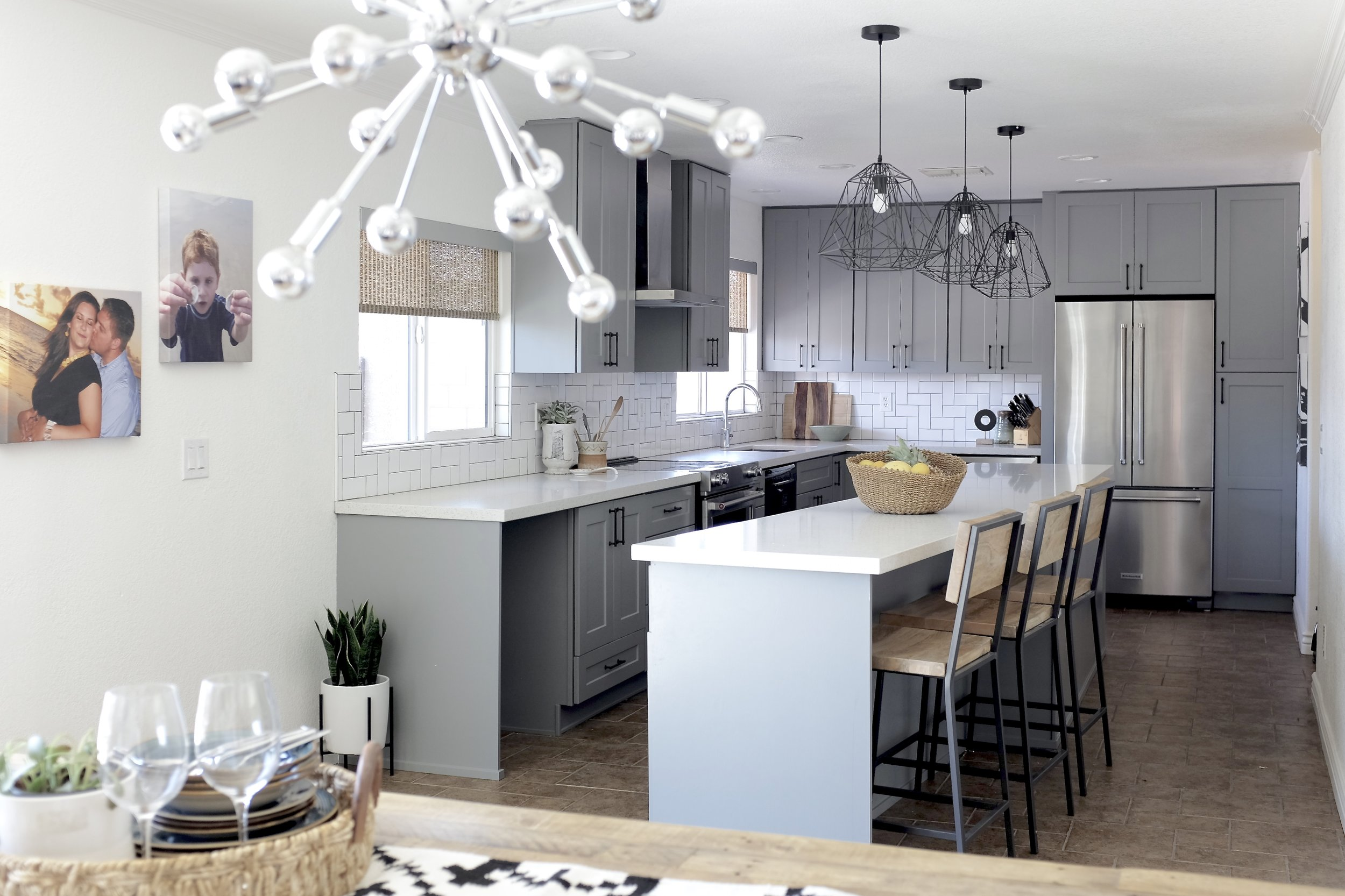 Gray Kitchen Cabinets with White Quartz Countertops, Sputnik chandelier and wire pendants