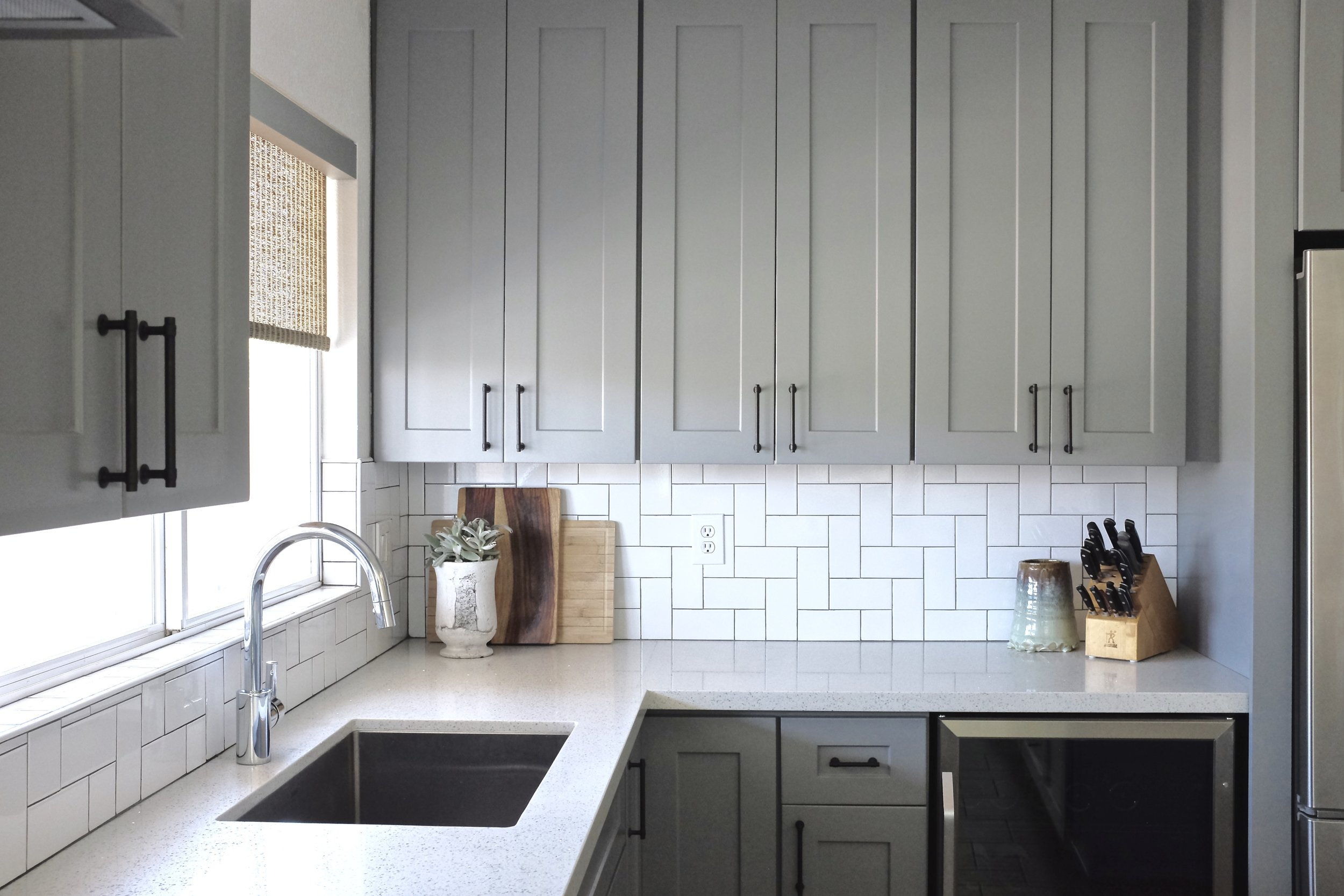 Gray Kitchen Cabinets, White Quartz, Herringbone Backsplash