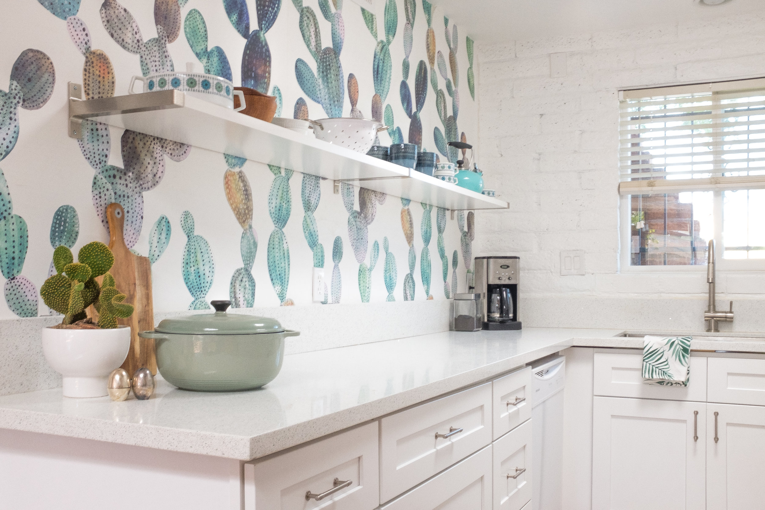 Cozy Cactus Wallpaper Kitchen with Ikea floating shelves, quartz countertop and white shaker cabinets