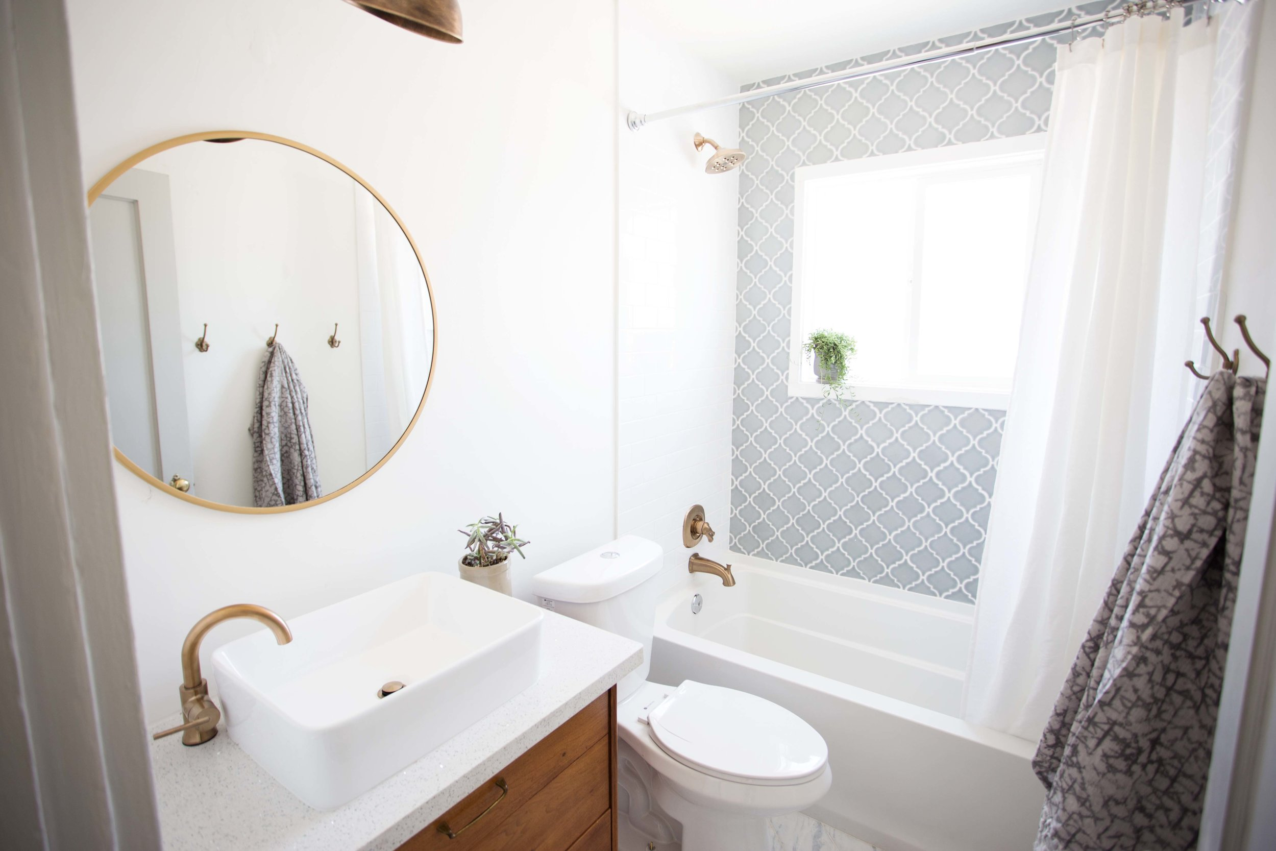 Arabesque style tile with subway tile and gold fixtures