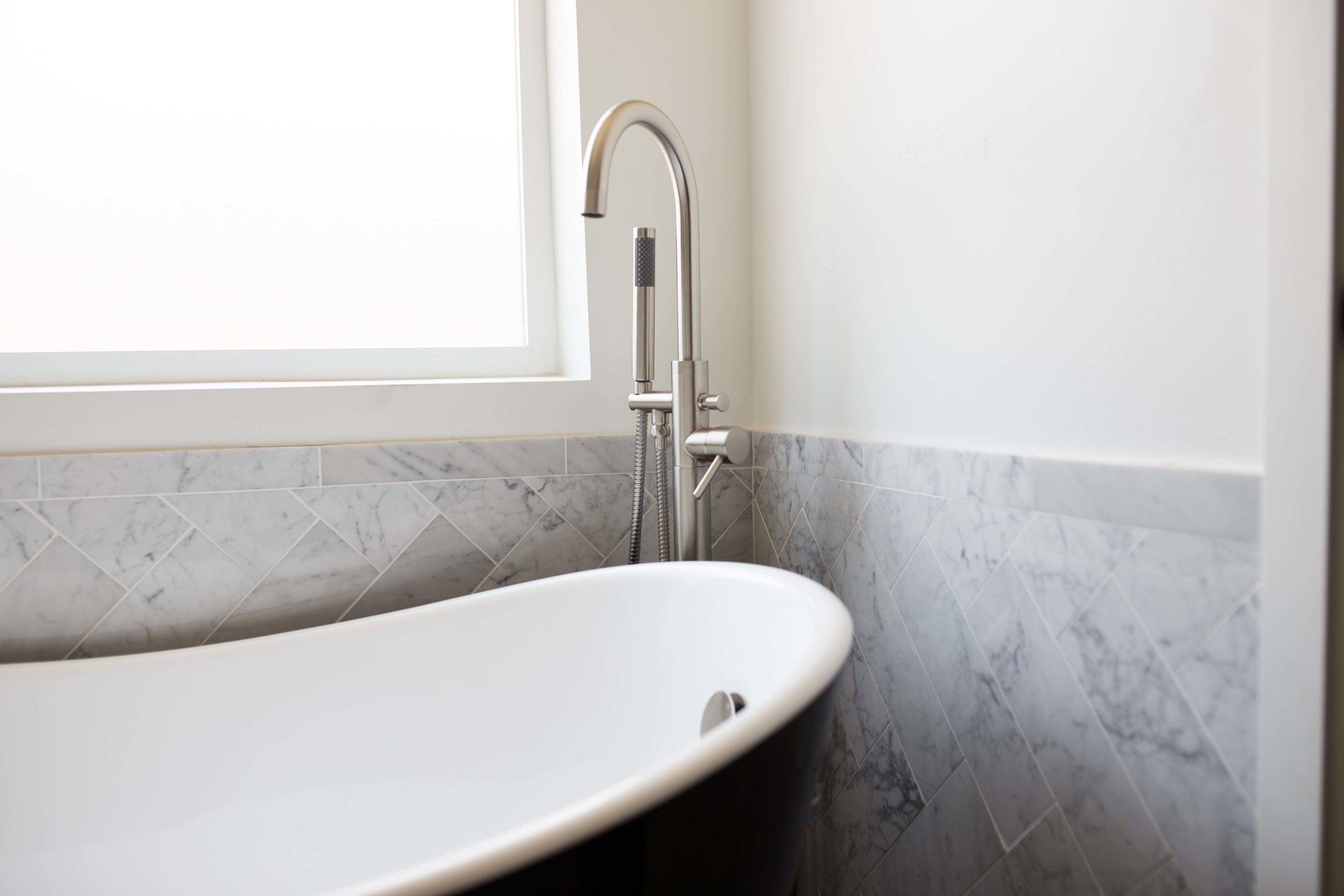 Signature Hardware soaking tub and tub filler faucet