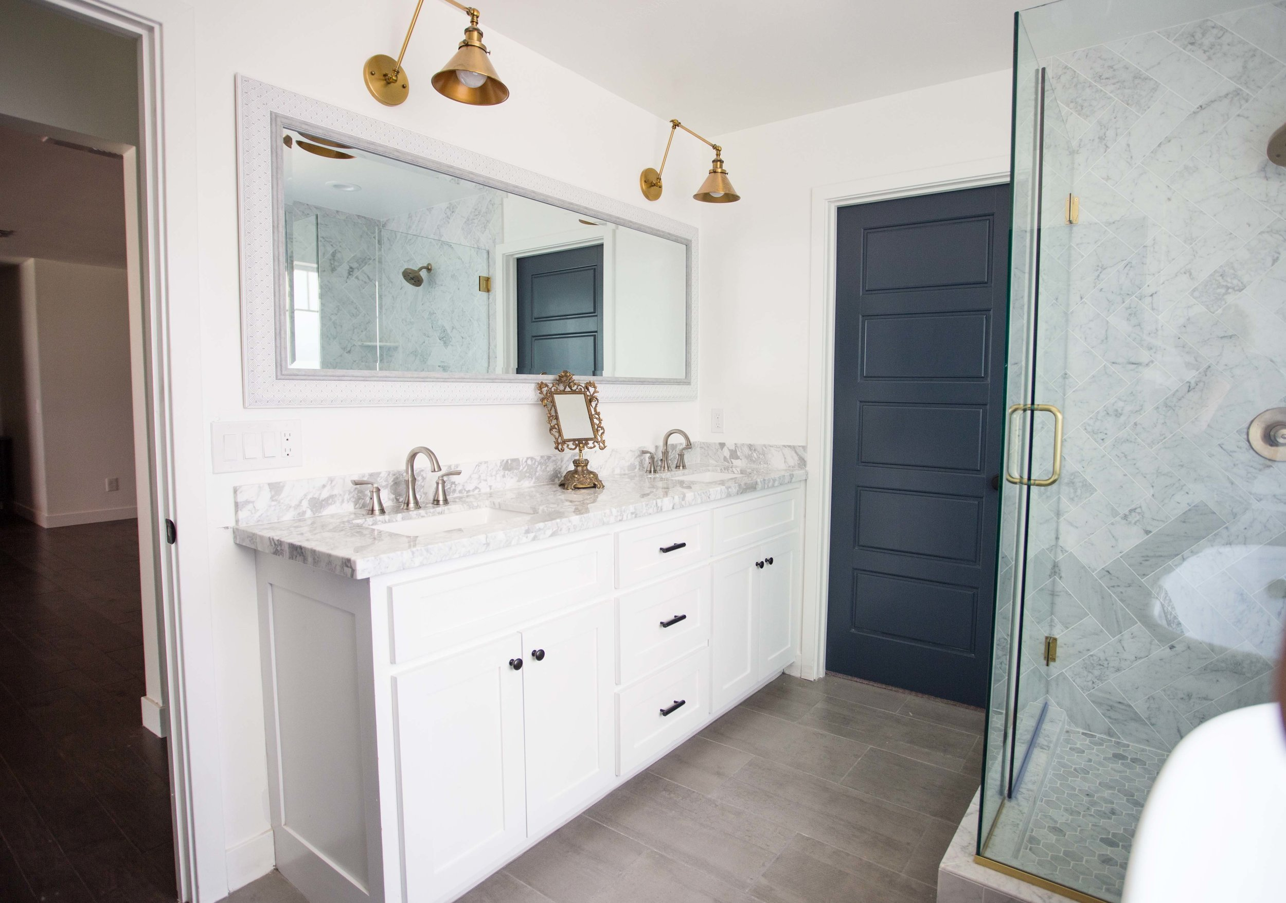 Clarendon Master Bath Vanity with carrara arabescato marble and brass sconces