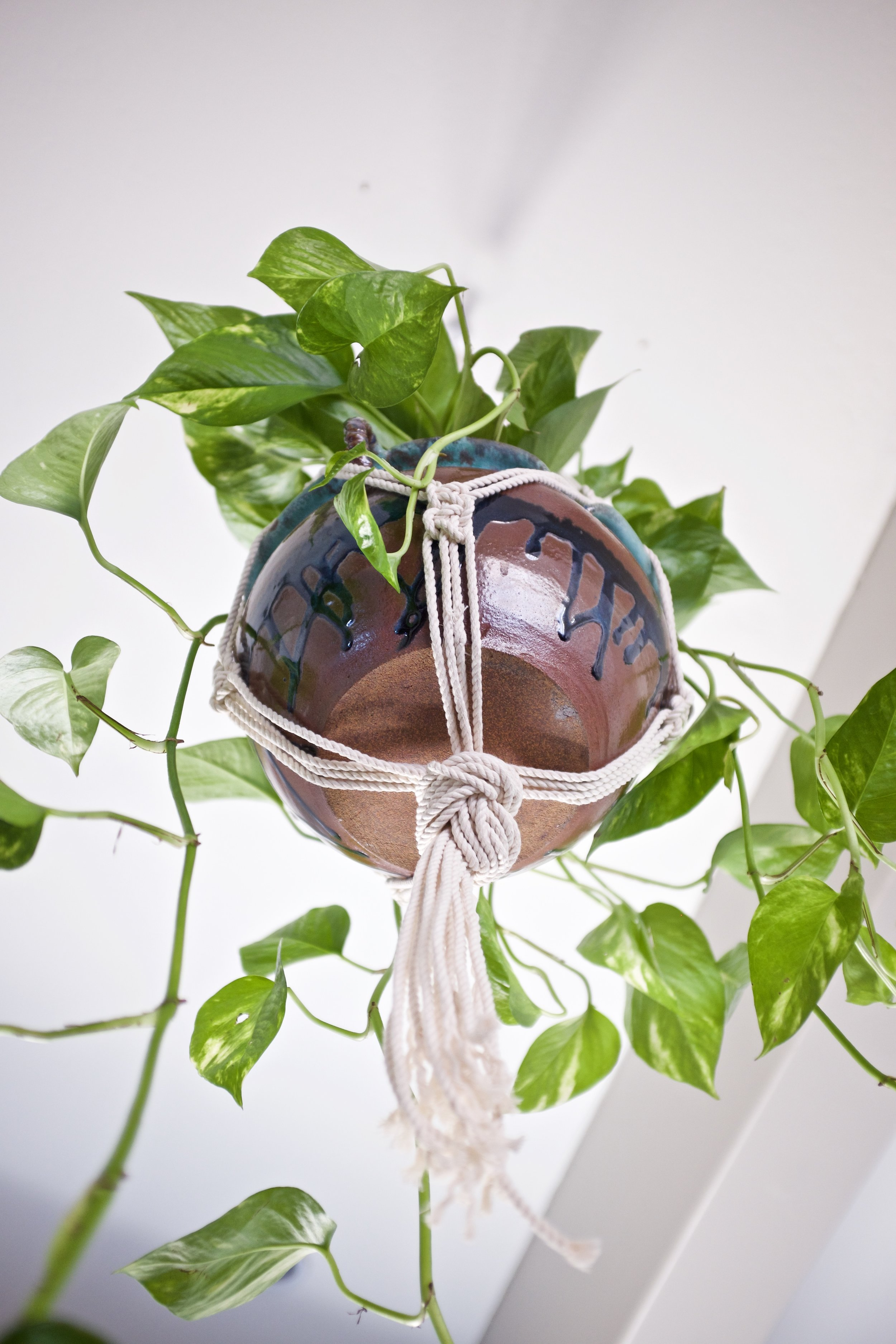 Macrame hanging planter with vintage pot