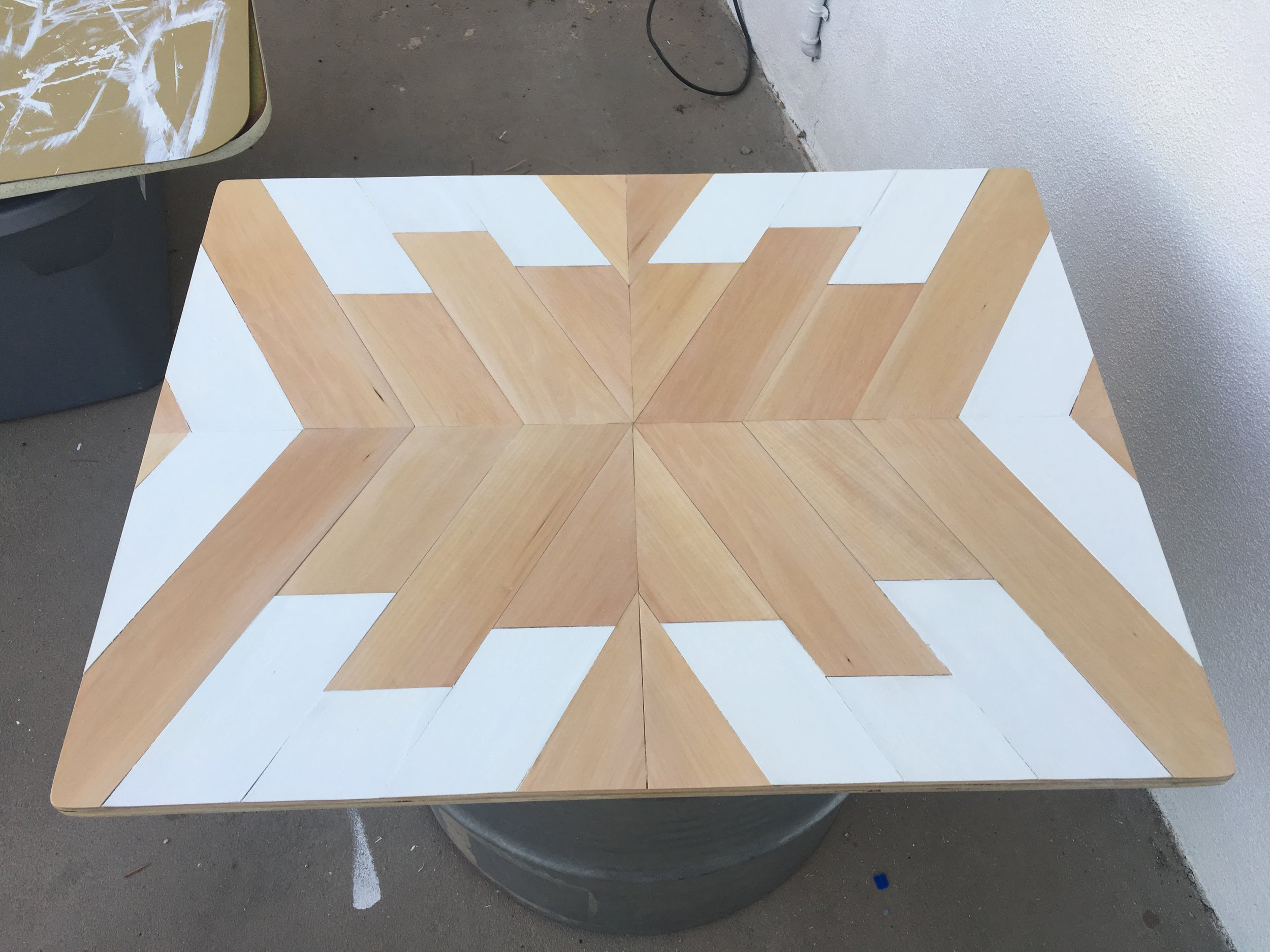 Putting an extra thick coat of poly on table