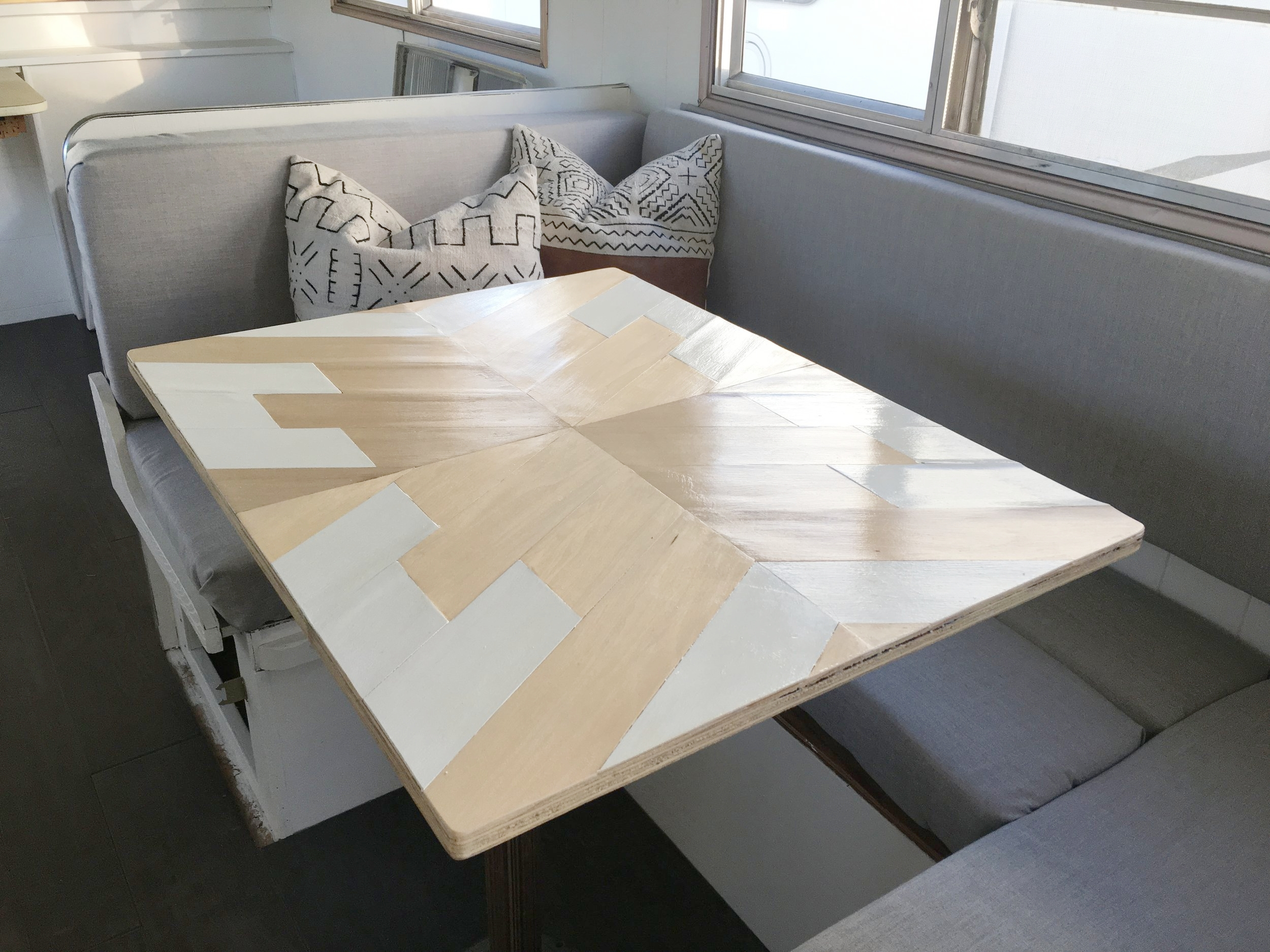 Geometric table in renovated camper