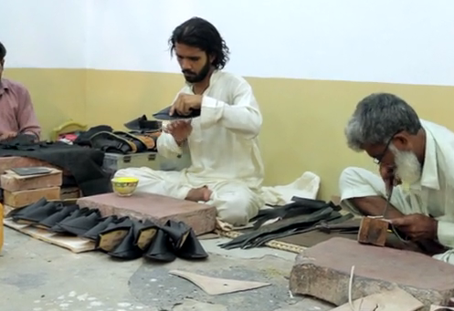 Craftsman making high quality Markhor shoes in Lahore, Pakistan