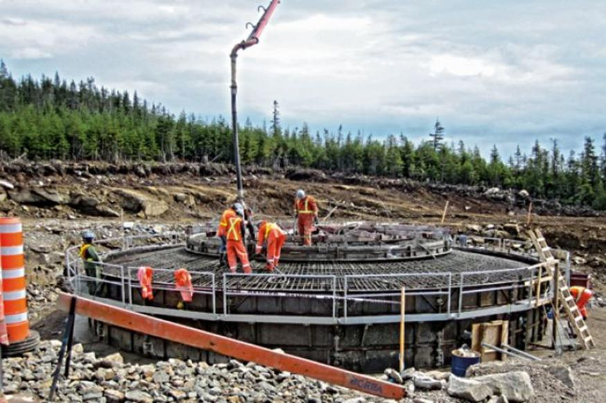 Source   :  ABF Inc . Pouring concrete at one of the foundations of the   Seigneurie de Beaupré wind park.