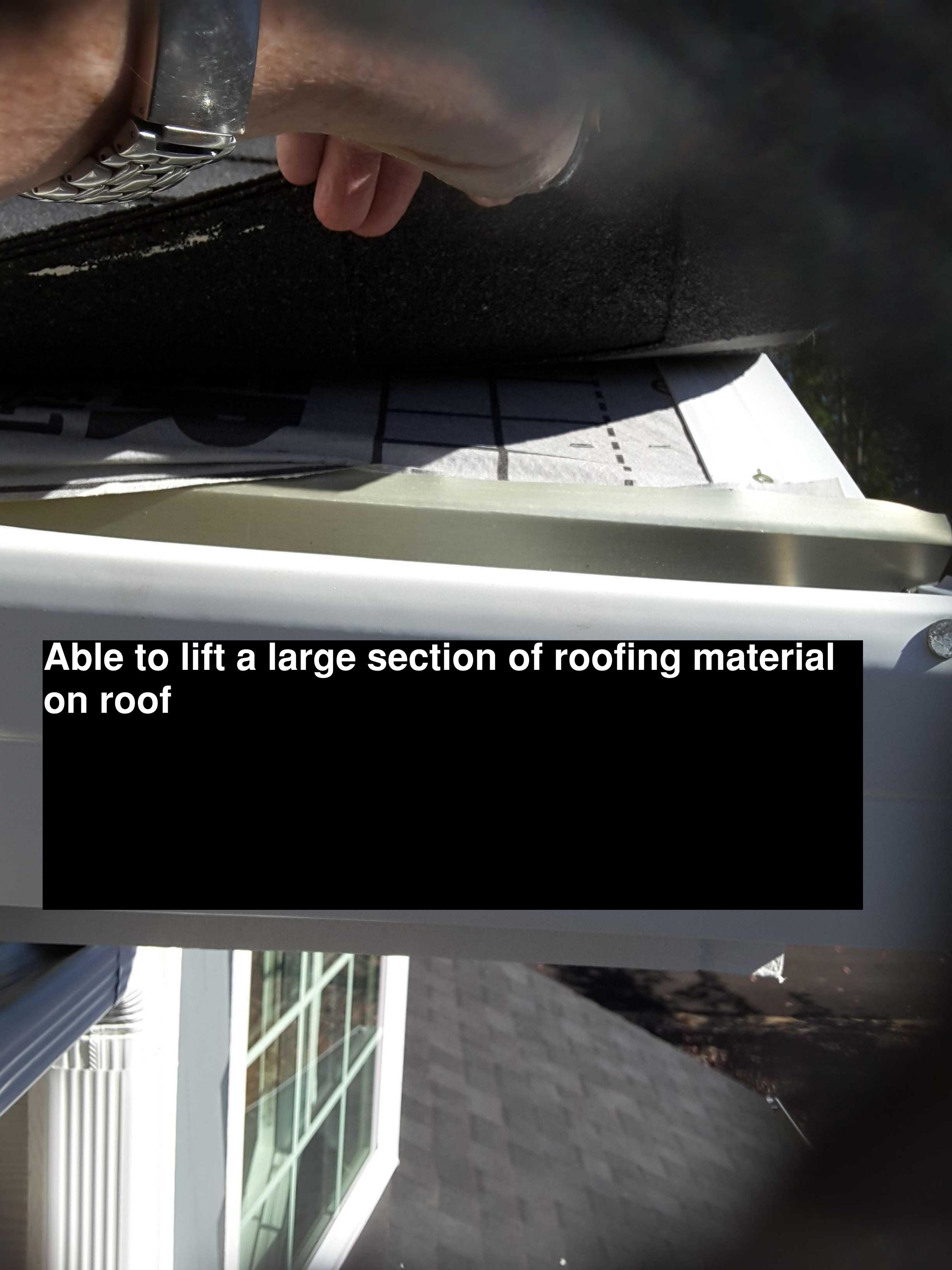 Roofing Material - For some reason I decided to lift up on this shingle tab during the inspection. The whole tab was not secured. The material used to cover roof sheeting also was installed incorrectly. Brand new roof.