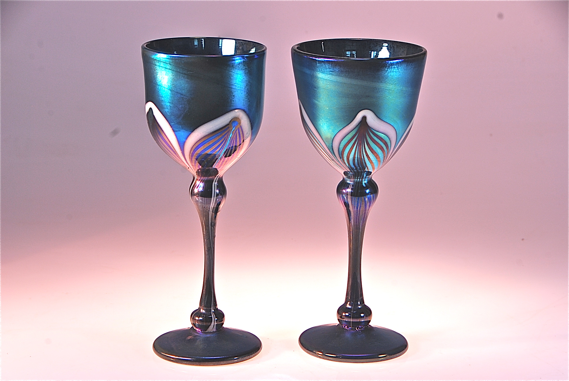 these are a couple of new Wine Goblets that are on the shopping cart.  Blue Luster decorated with a feather pattern. Hand blown glass by rick strini  2014