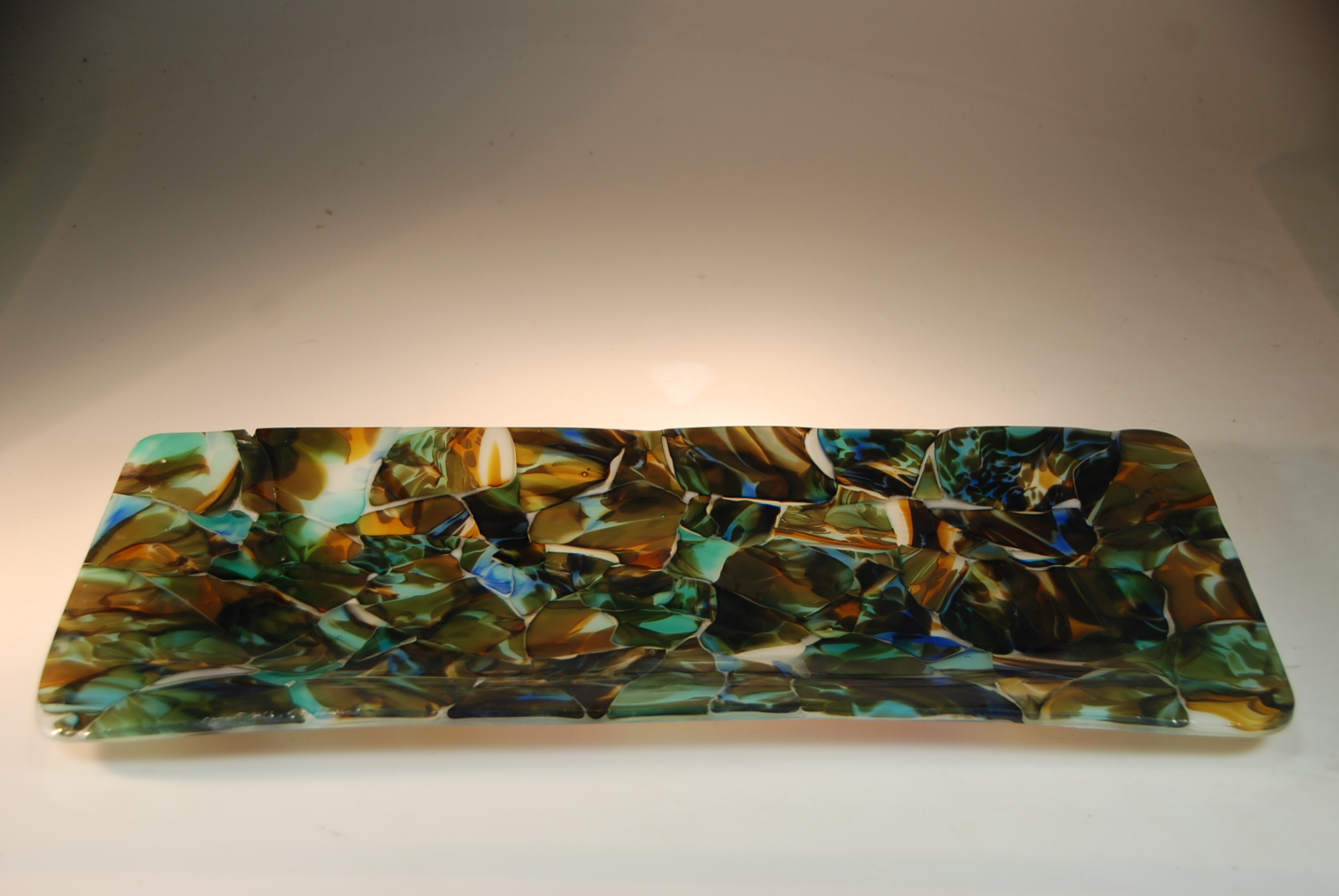 """Serving platter """"Adventures in Paradise"""" fused, slumped glass mosaic of recycled blown glass."""