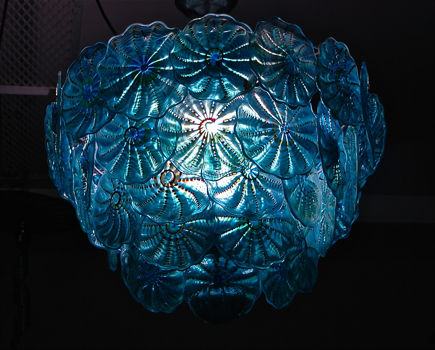 Rondel Chandelier, 46 pieces hand blown rondels, Turquoise cathedral, decorated silver luster, ruby glass pearls, white opal lip and applied iridescence.