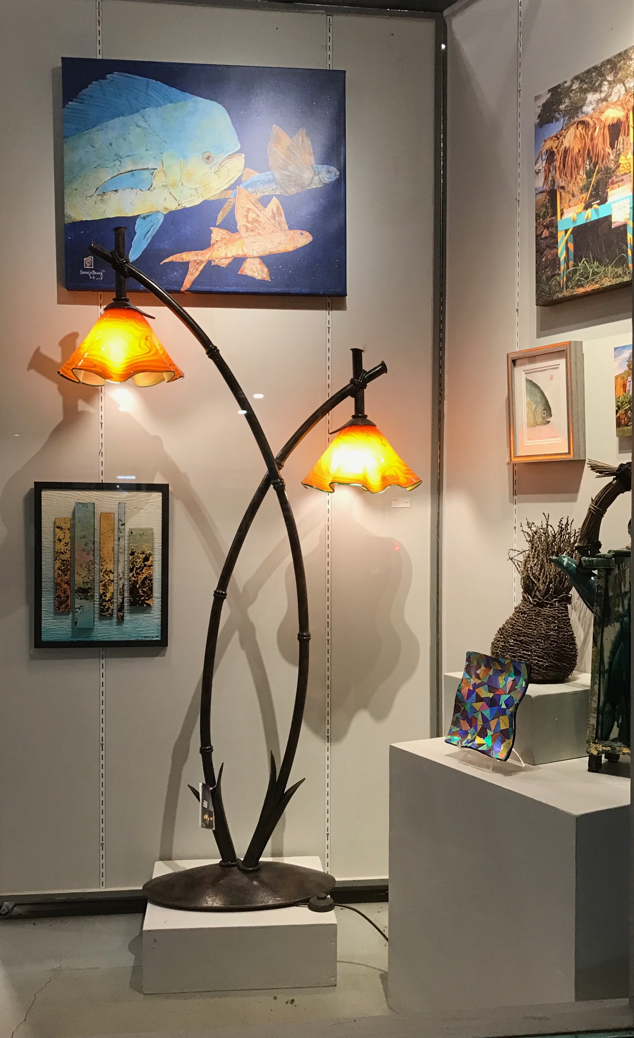new display in Maui Crafts Guild with the Double Bamboo artistically hand forged iron andStrini Art Glass blown glass shades.