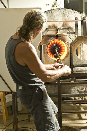 trying to get the blowing equipment on and get working. artist rick strini