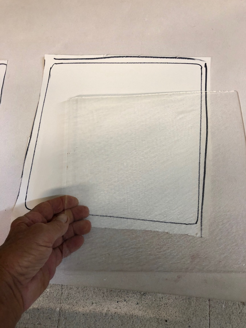 """Here we cut a piece to fit the size of the plate to lay the broken glass on .  This helps prevent """"crawling"""" and allows a smooth even fuse.  more to come.  rick"""