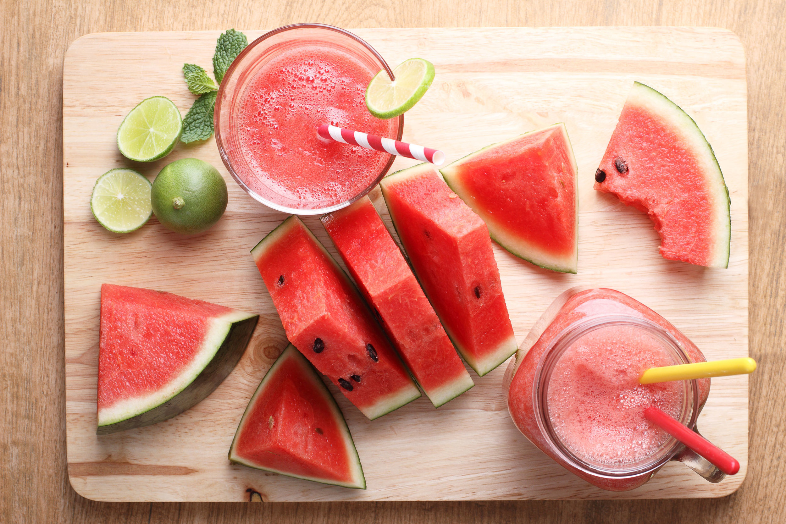 Healthy watermelon lime smoothie and fresh watermelon on a wooden background.jpg