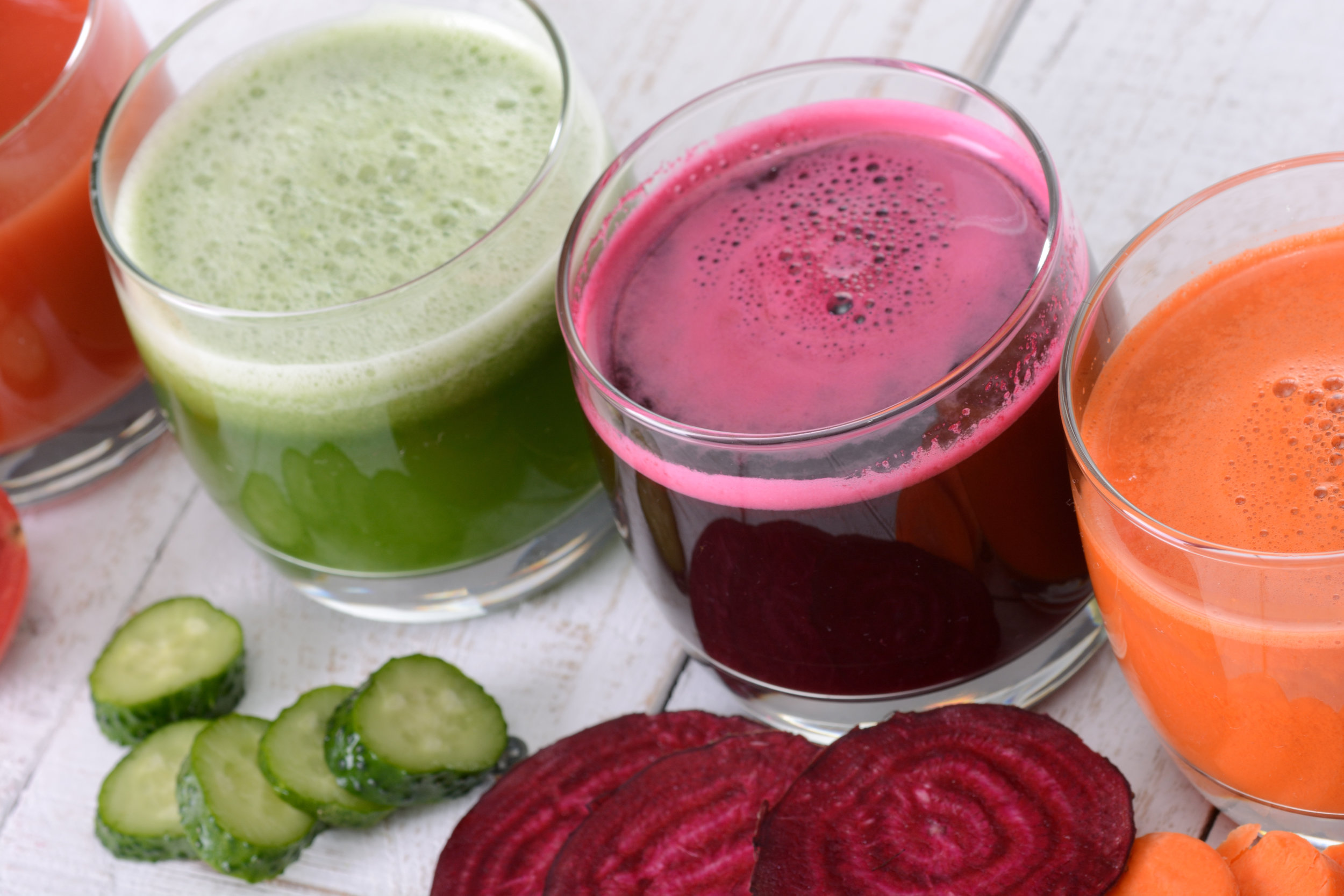 vegetable juices green purple orange healthy.jpg