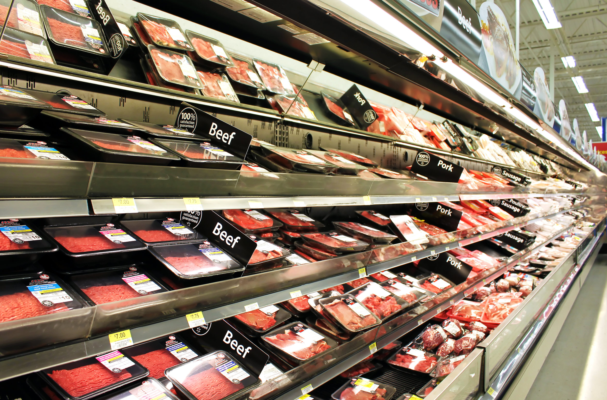 Meat and poultry products on shelves in a supermarket.jpg