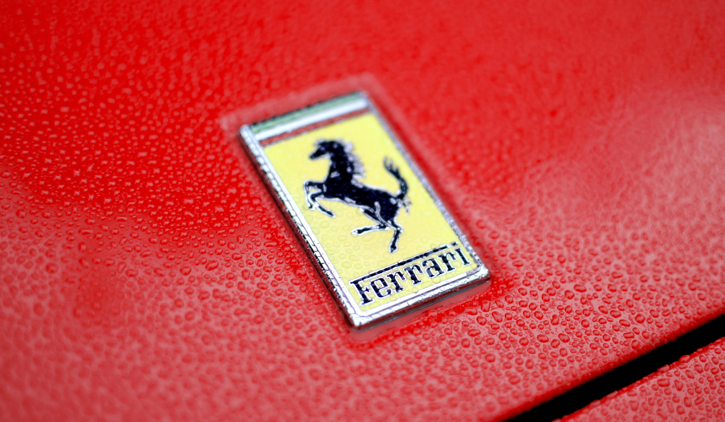 By Axion23 (Ferrari Emblem) [CC BY 2.0 (http://creativecommons.org/licenses/by/2.0)], via  Wikimedia Commons .