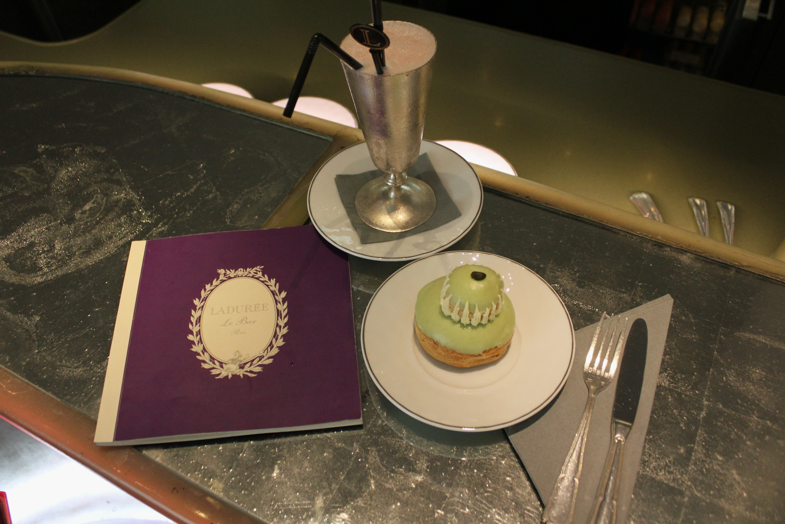 Trying the rose milkshake and pistachio religieuse