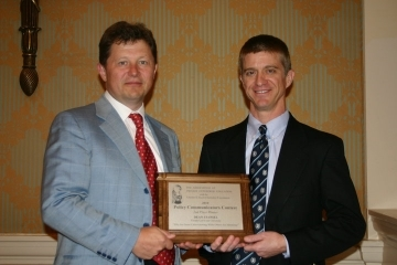 """Dean Stansel (right) receiving the 2010 Association of Private Enterprise Education (APEE)/Koch Foundation Policy Communicators Contest 2nd Prize from APEE President Roberto Salinas-Leon of the Mexico Business Forum (left) on April 12, 2010 at Caesar's Palace in Las Vegas, Nevada for his paper entitled """"Why Some Cities Are Growing and Others Shrinking."""""""