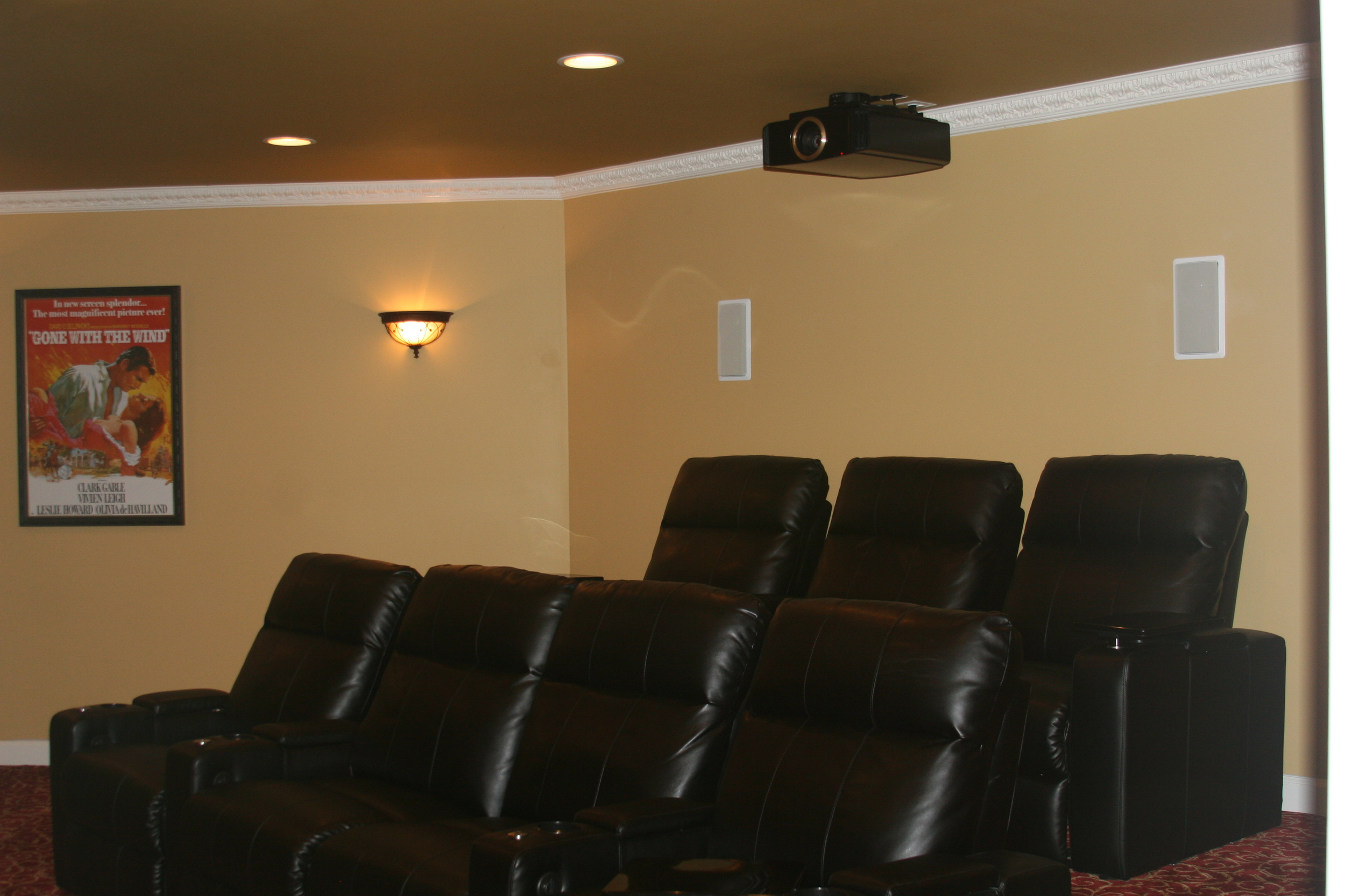 Home Theater System with projector, screen and in wall speakers.